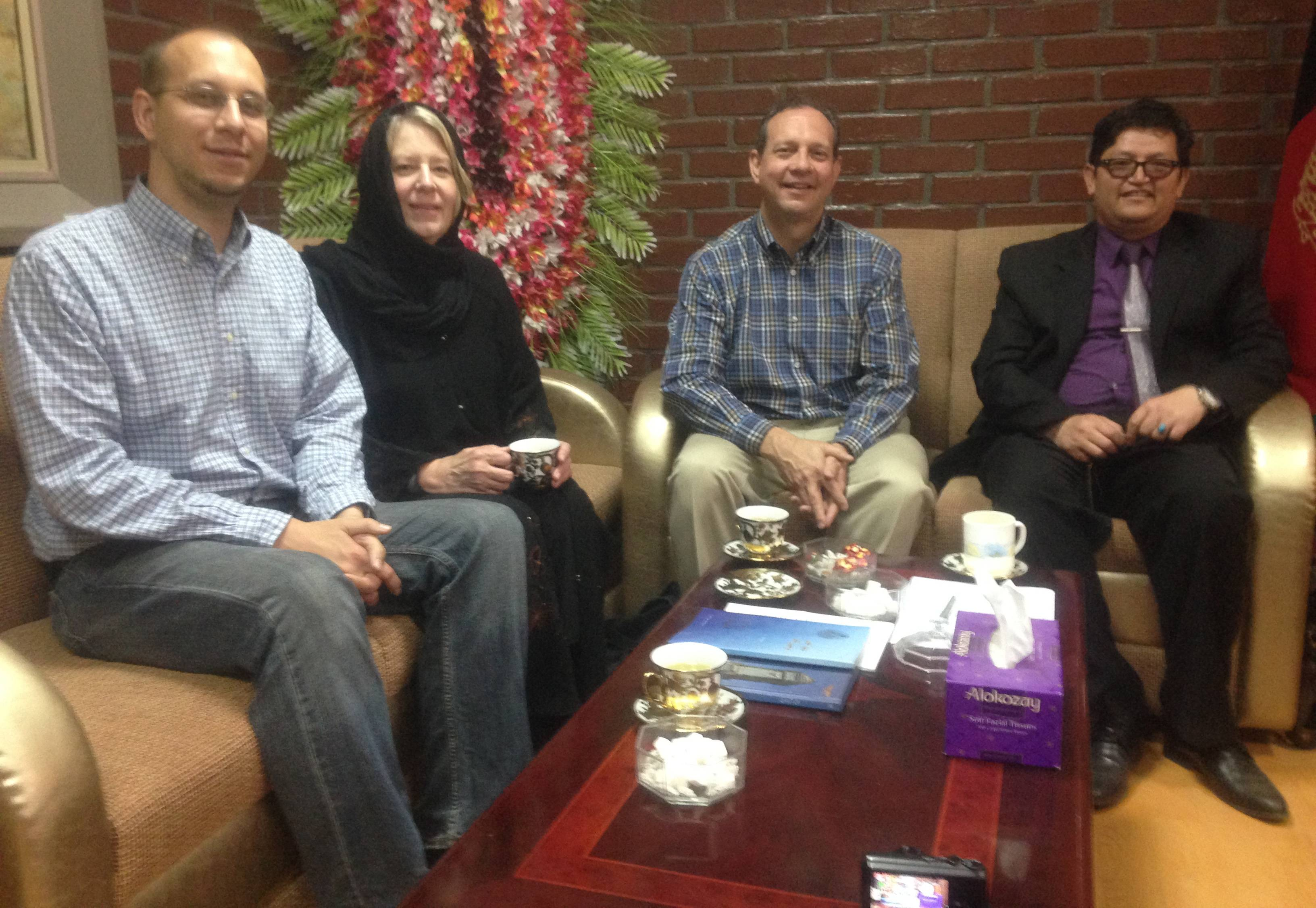 This photo taken on April 22 shows, from left, slain American John Gabel, his wife Teresa, and his father Gary Gabel sitting with Mohammad Hadi Hedayati, Kabul University's vice chancellor, at Kabul University in Kabul, Afghanistan.