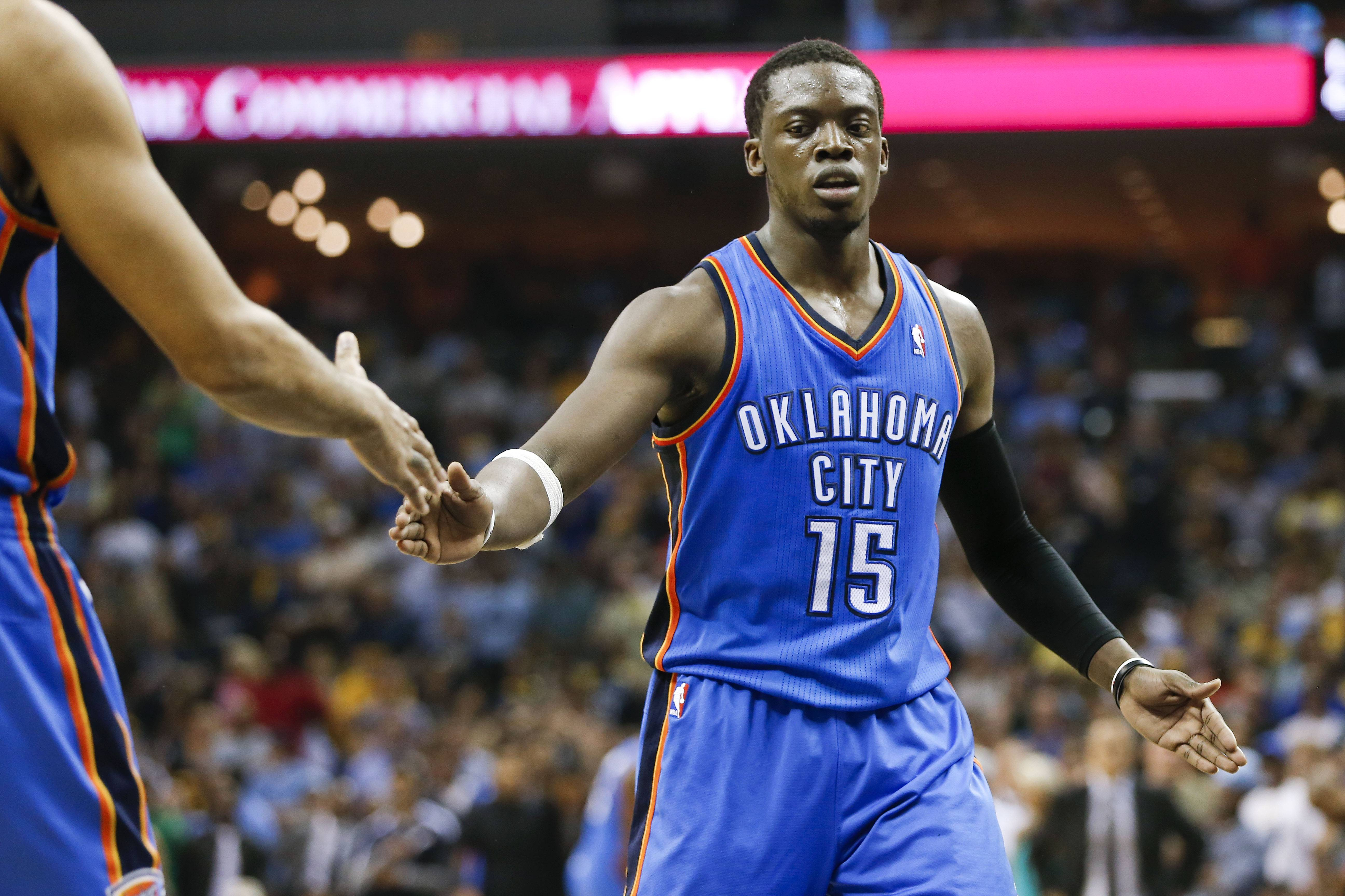 Oklahoma City Thunder guard Reggie Jackson is congratulated after making a free throw in the final seconds of overtime in Game 4 of an opening-round NBA basketball playoff series against the Memphis Grizzlies Saturday in Memphis, Tenn. Jackson scored 32 points as Oklahoma City won 92-89.