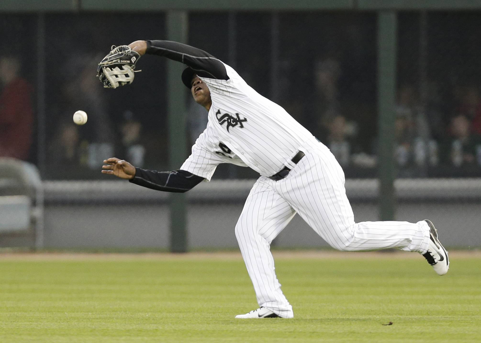 Chicago White Sox right fielder Dayan Viciedo cannot catch a ball hit by Tampa Bay Rays' Sean Rodriguez during the fifth inning of a baseball game in Chicago, Saturday, April 26, 2014.