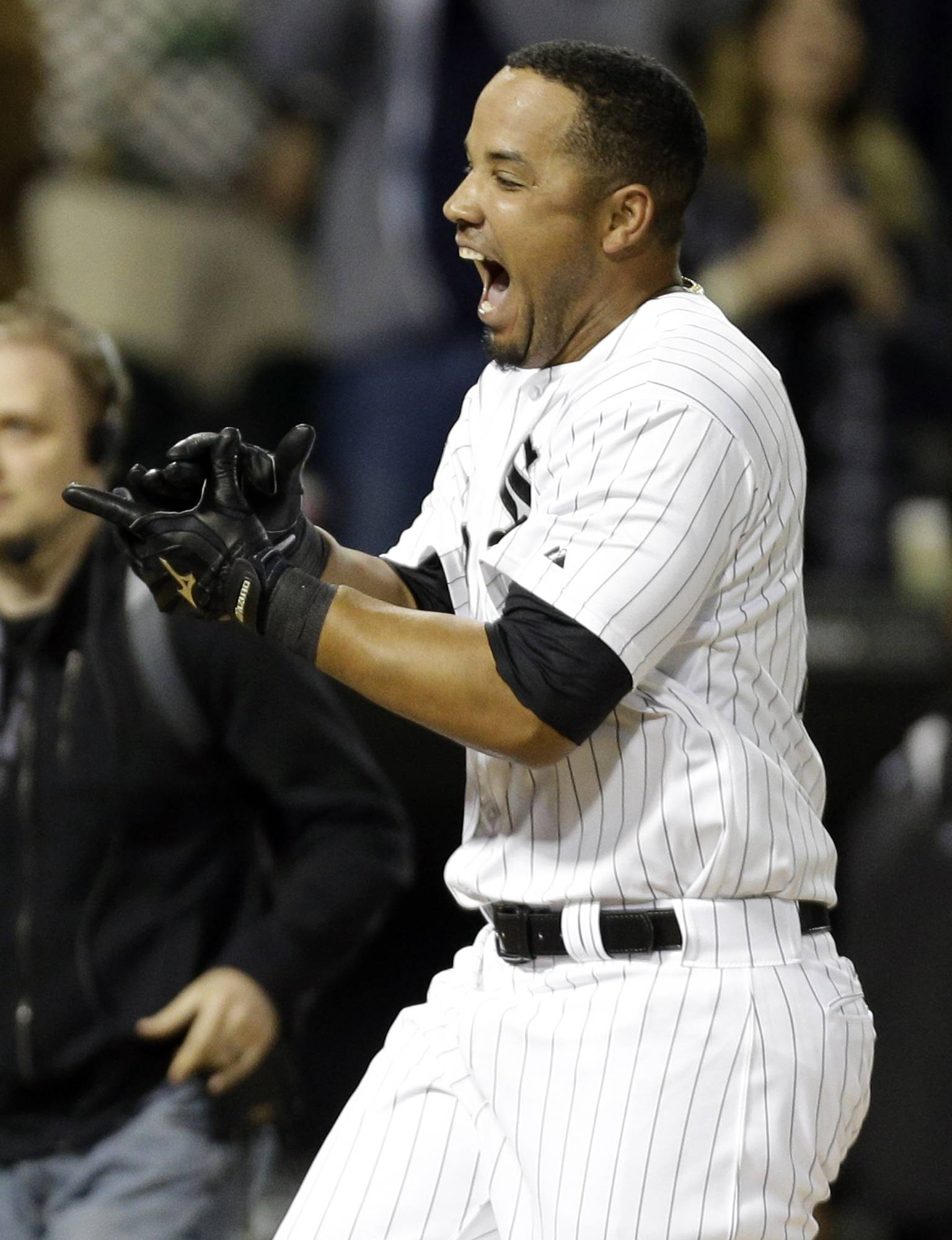 Jose Abreu celebrates as he rounds the bases after hitting a grand slam against the Tampa Bay Rays during the ninth inning of a baseball game on Friday, April 25, 2014.