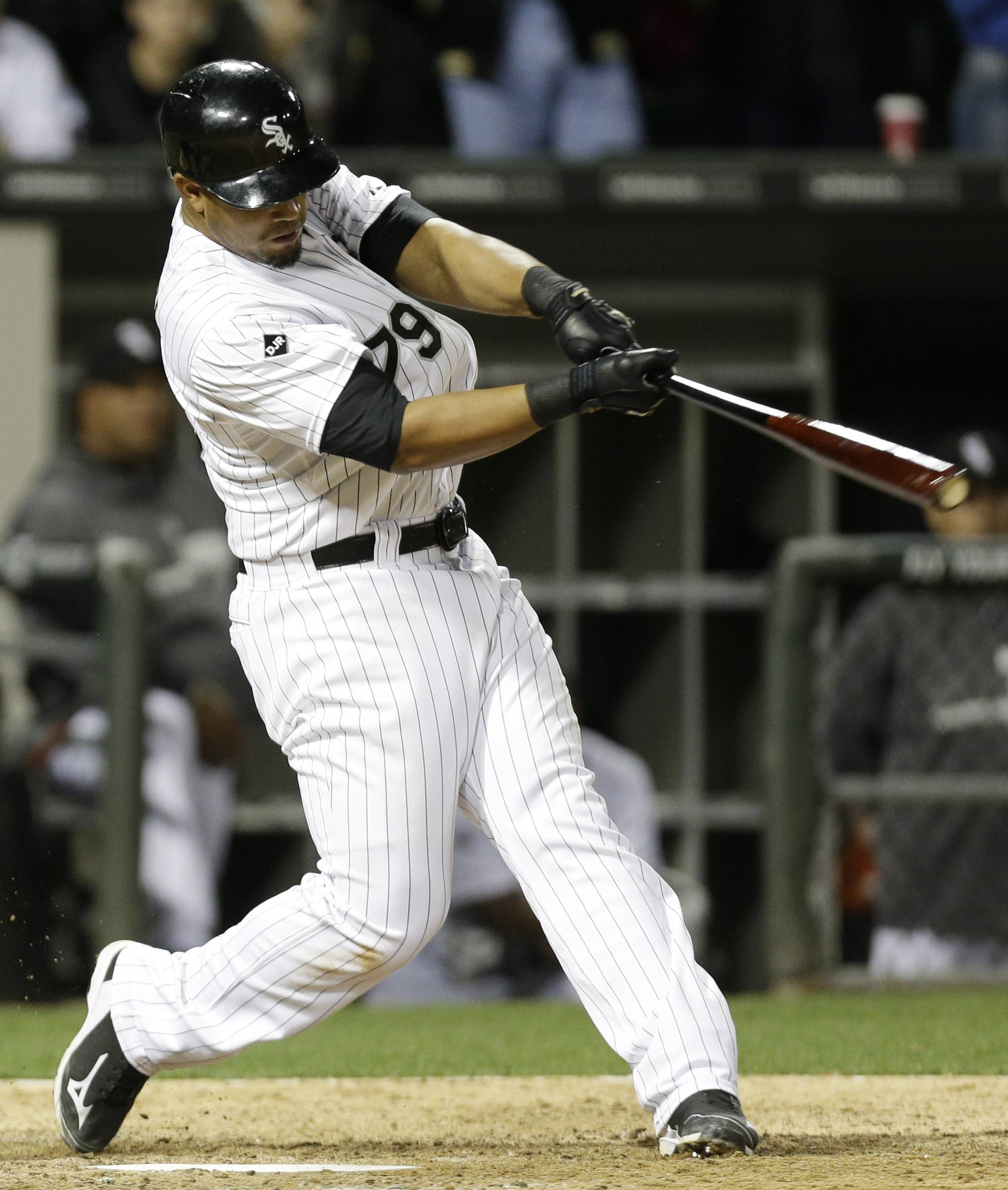 Jose Abreu hits a grand slam against theTampa Bay Rays during the ninth inning of a baseball game in Chicago on Friday, April 25, 2014. The White Sox won 9-6.