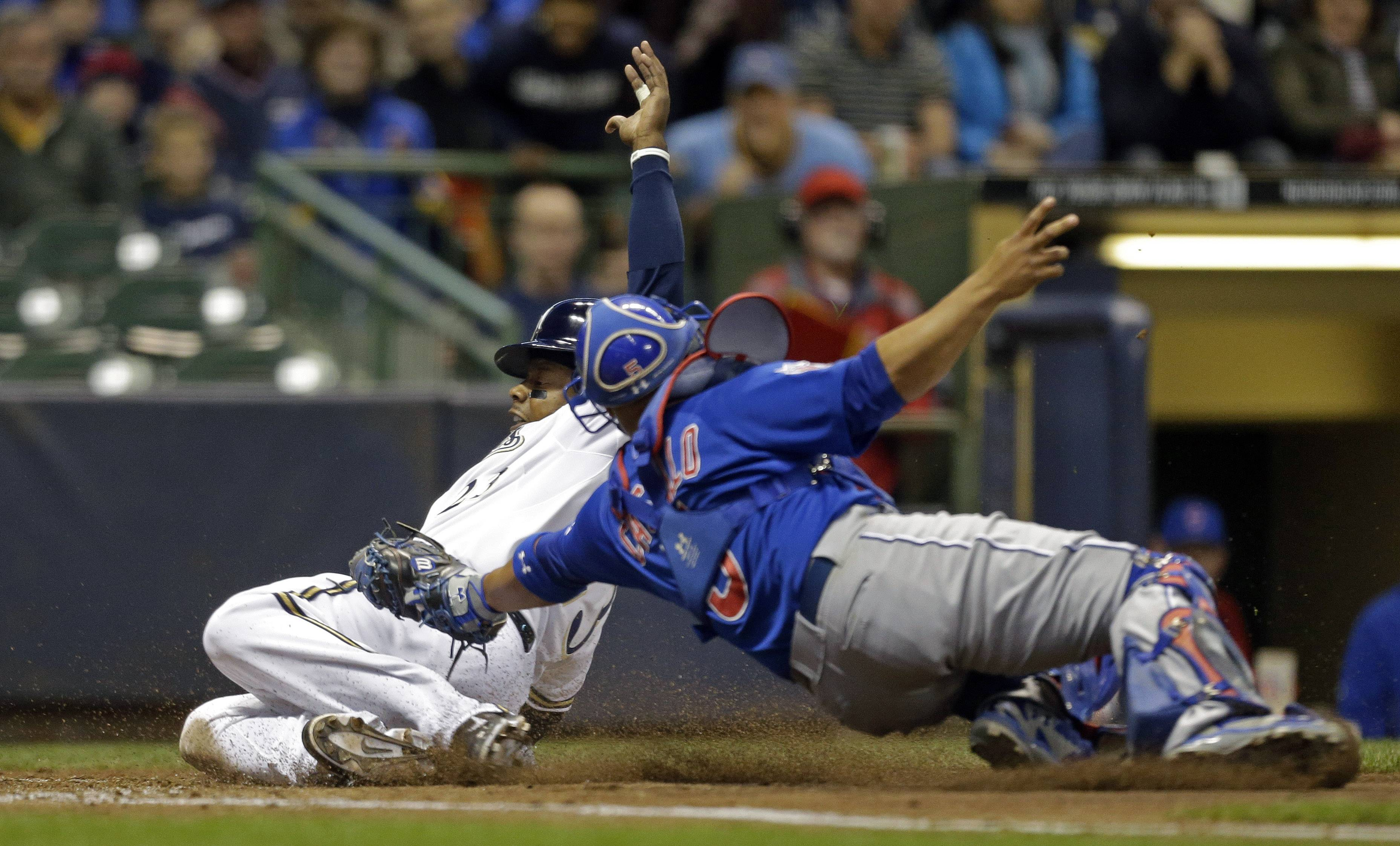 Chicago Cubs catcher Welington Castillo, right, tags out Milwaukee Brewers' Rickie Weeks during Saturday's game in Milwaukee. The Brewers beat the Cubs 5-3.