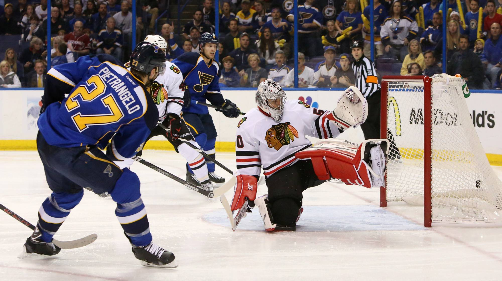 St. Louis Blues defenseman Alex Pietrangelo scores past Chicago Blackhawks goaltender Corey Crawford to tie the game in third period action during Game 5 of a Western Conference quarterfinal playoff game Friday, April 25, 2014, at the Scottrade Center in St. Louis.