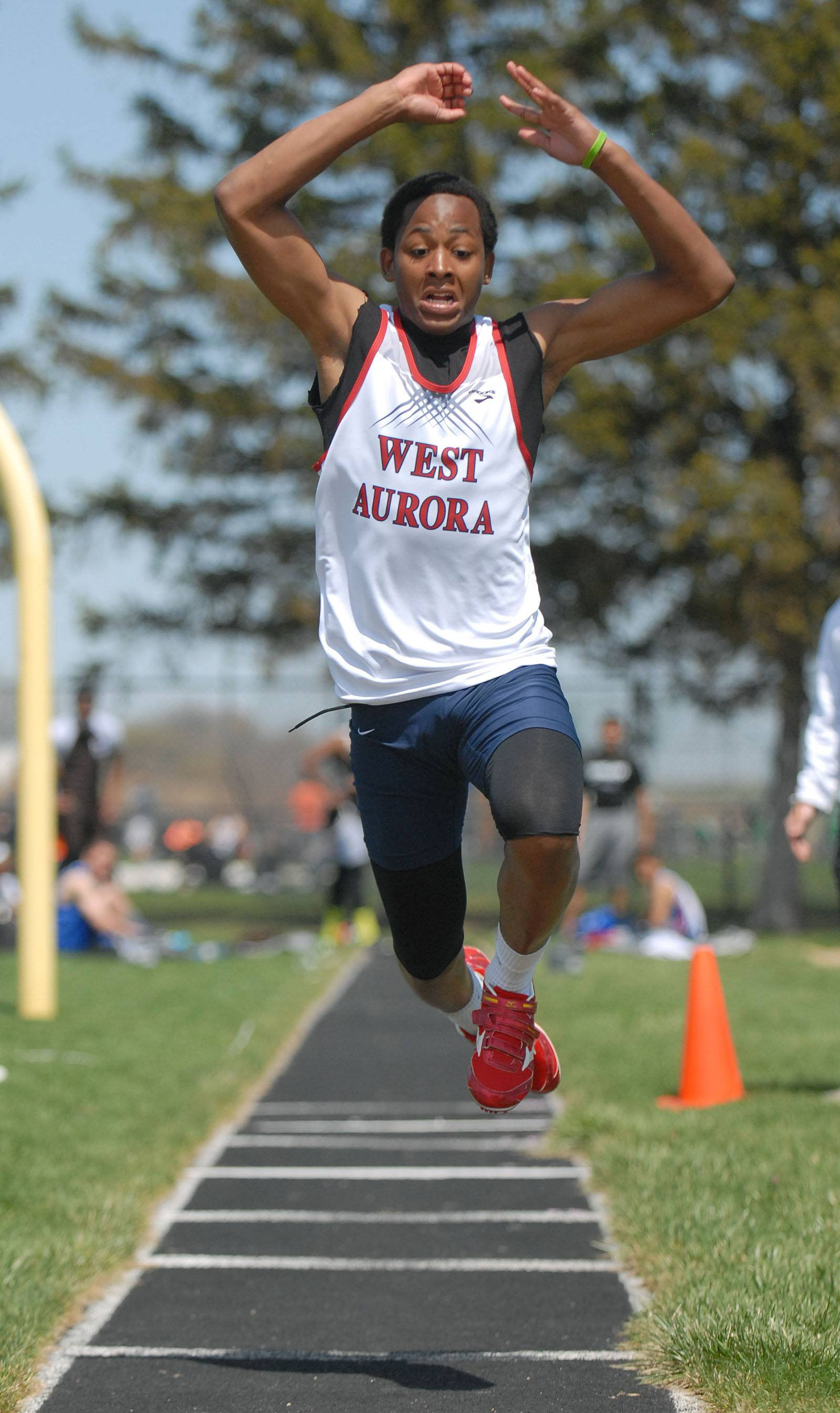 West Aurora's Davion Cross in the finals of the triple jump at Kaneland's Peterson Prep Invitational on Saturday, April 26.