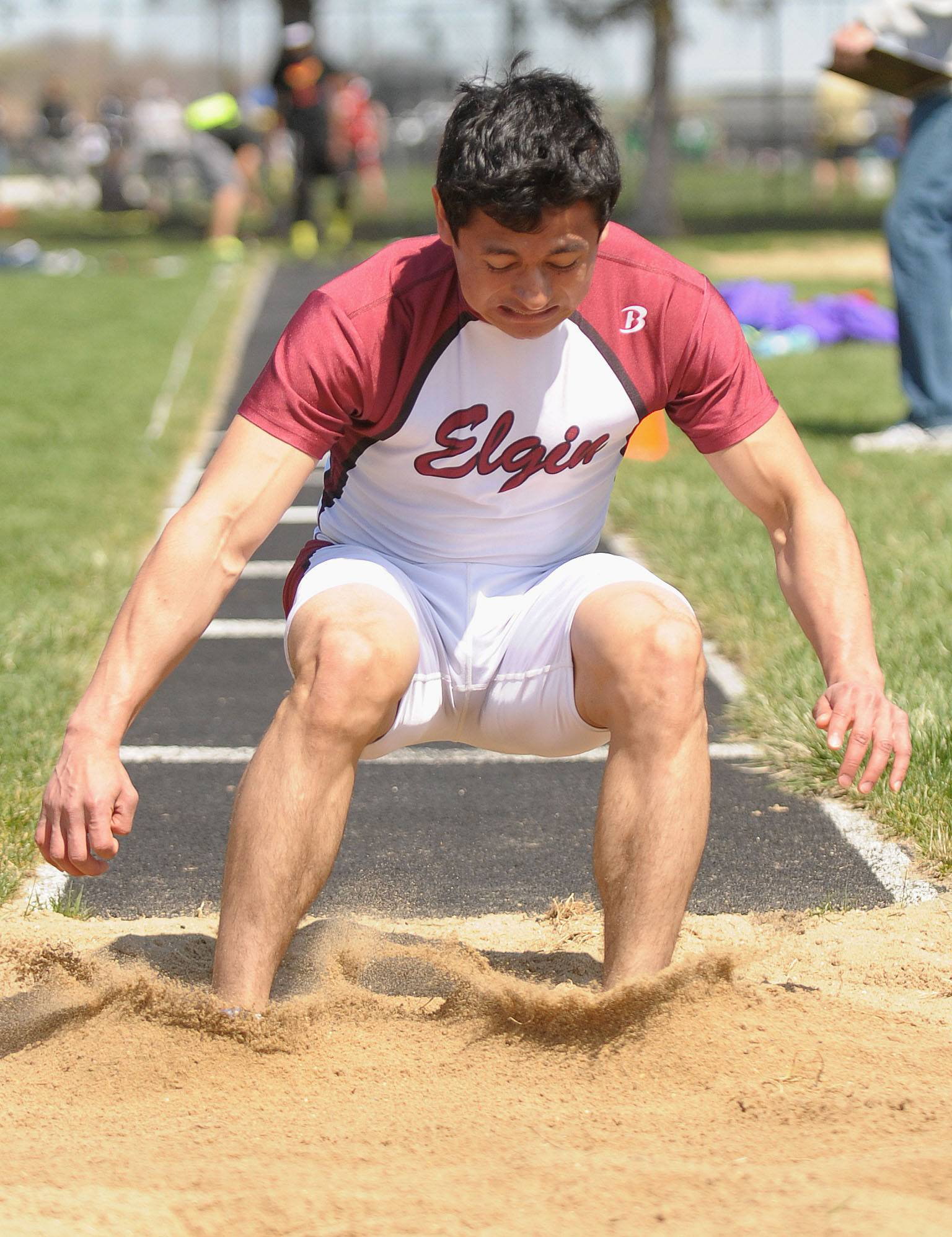 Elgin's Jhon Payne (cq) in the finals of the triple jump at Kaneland's Peterson Prep Invitational on Saturday, April 26.