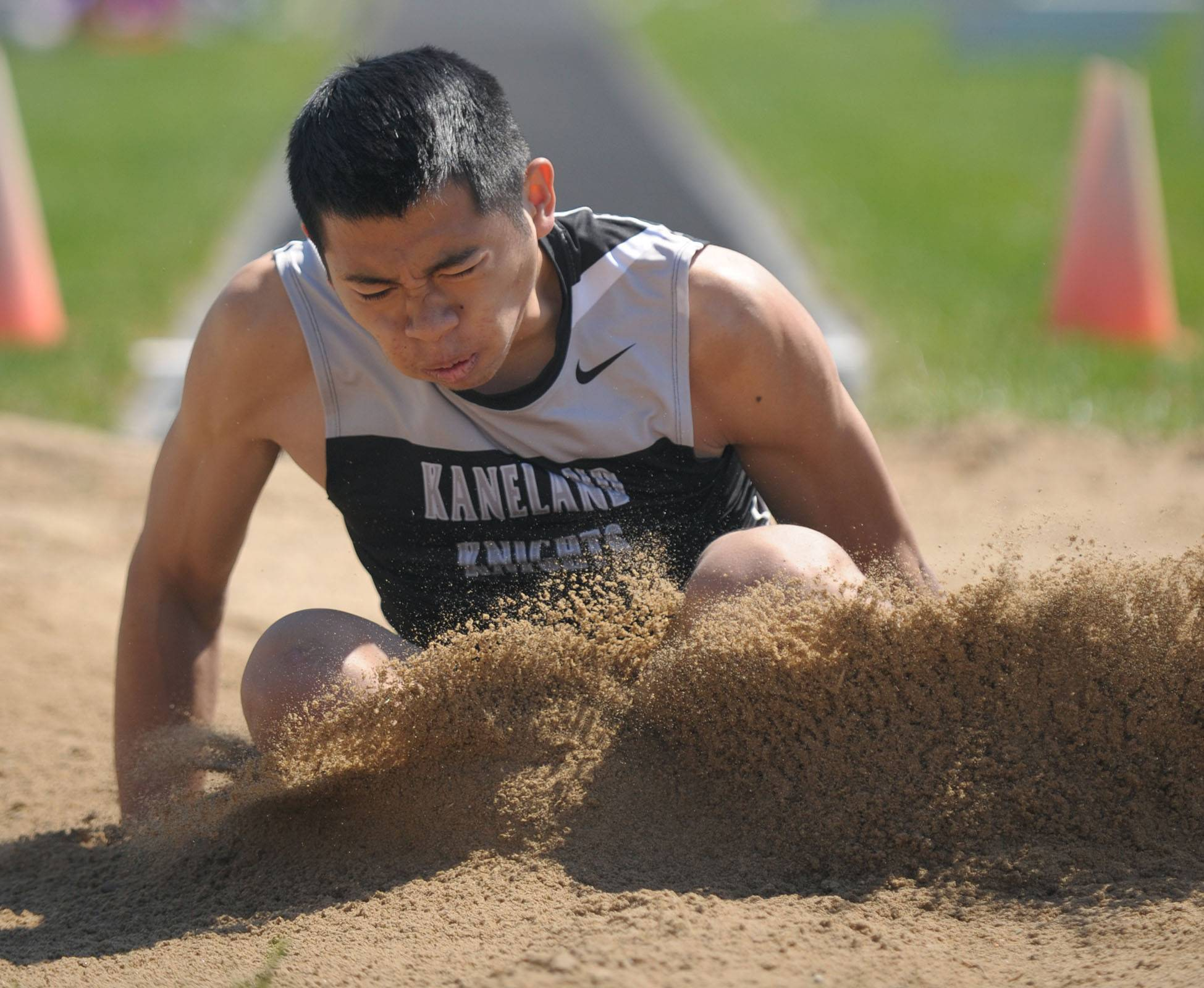 Kaneland's Ben Barnes lands in the long jump finals at Kaneland's Peterson Prep Invitational on Saturday, April 26.