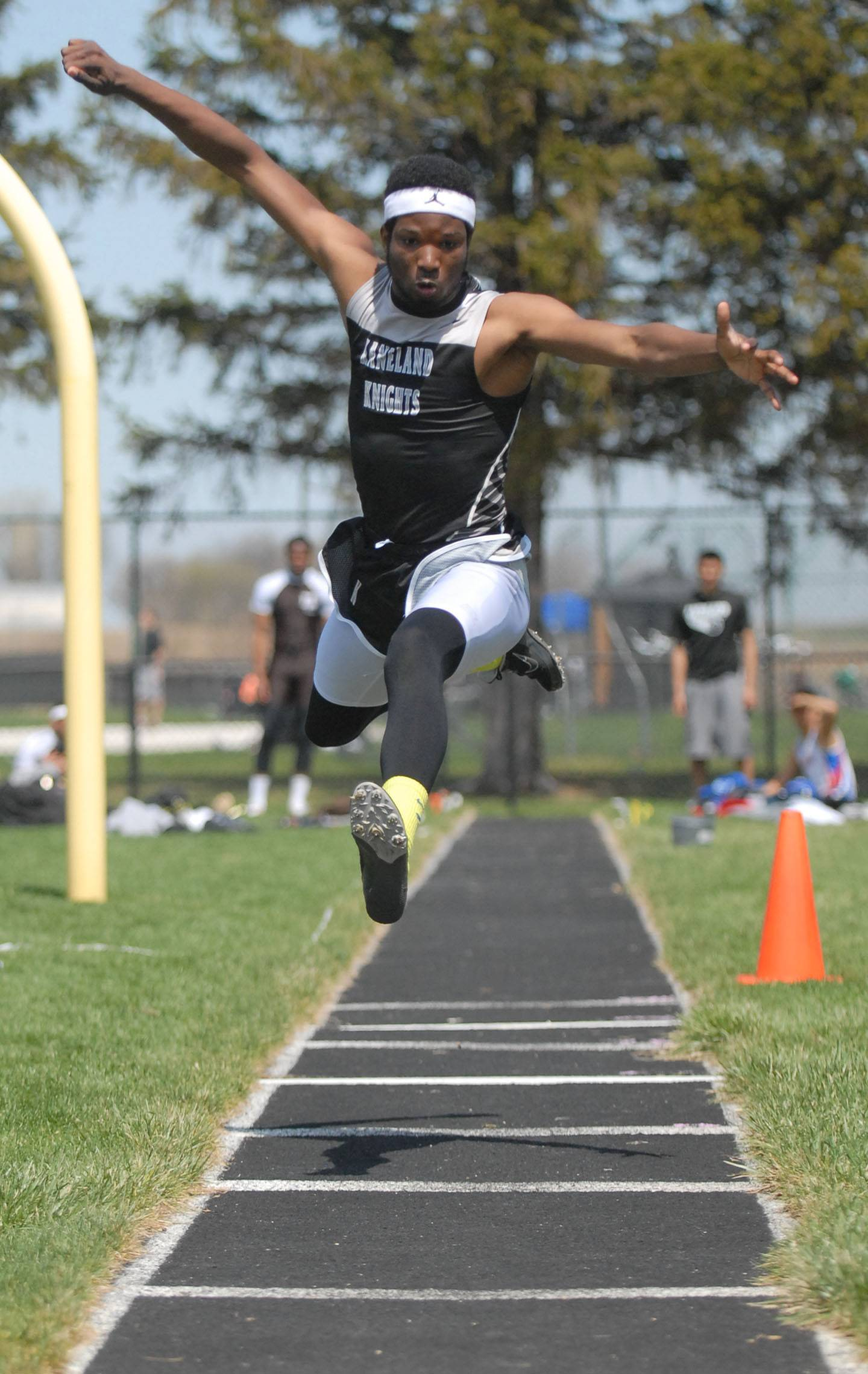 Kaneland's Dalvell Triplett in the finals of the triple jump at Kaneland's Peterson Prep Invitational on Saturday, April 26.