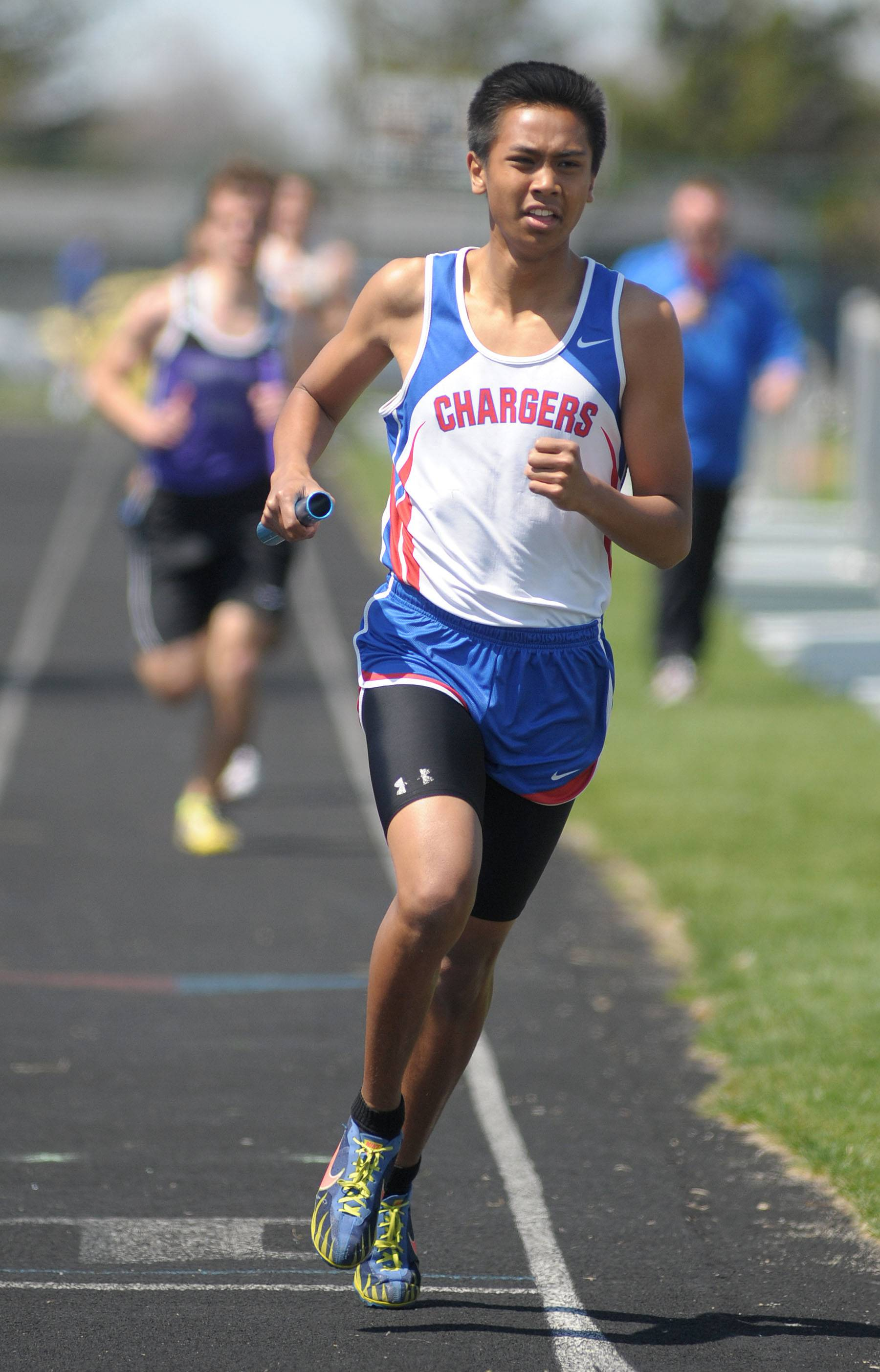 Dundee-Crown's Sam Parreno in the 4 x 800 meter relay at Kaneland's Peterson Prep Invitational on Saturday, April 26.