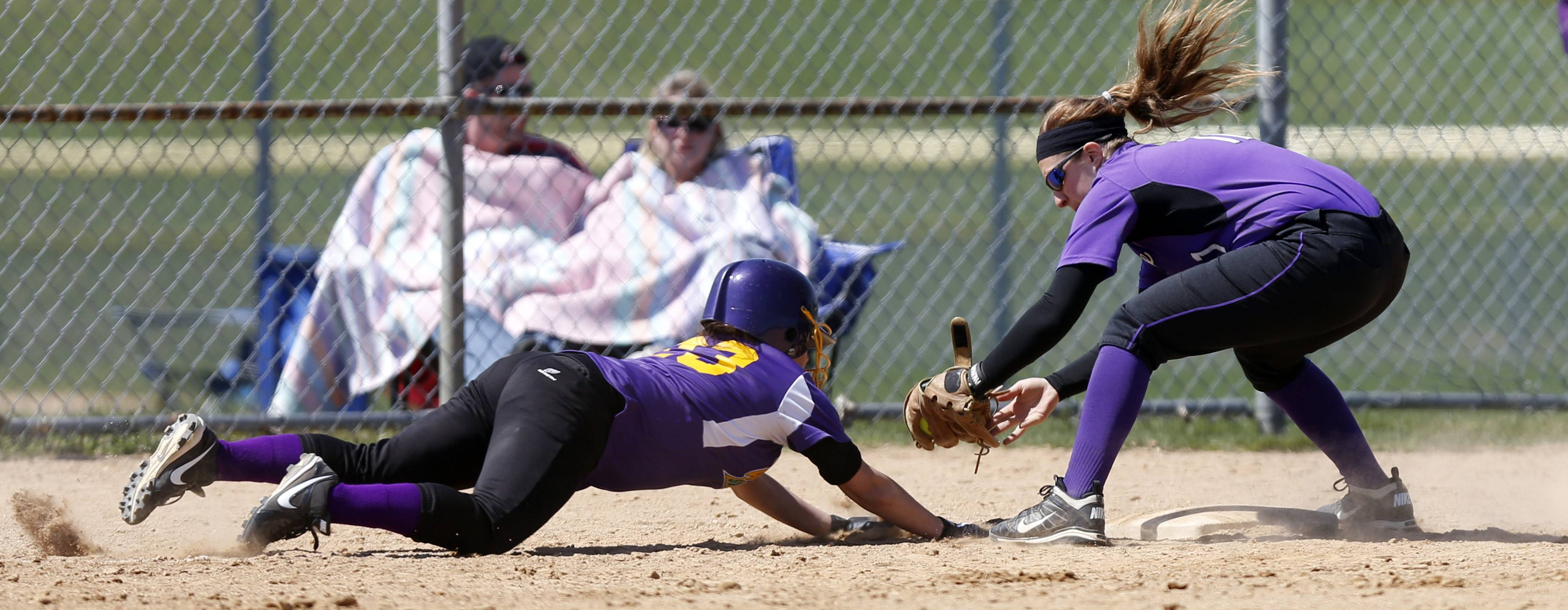 Hampshire's Ellie Lapi lays the tag and the out down on Waukegan's Coraima Garza during the Larkin Slugfest softball tournament Saturday at the Elgin Sports Complex in Elgin.