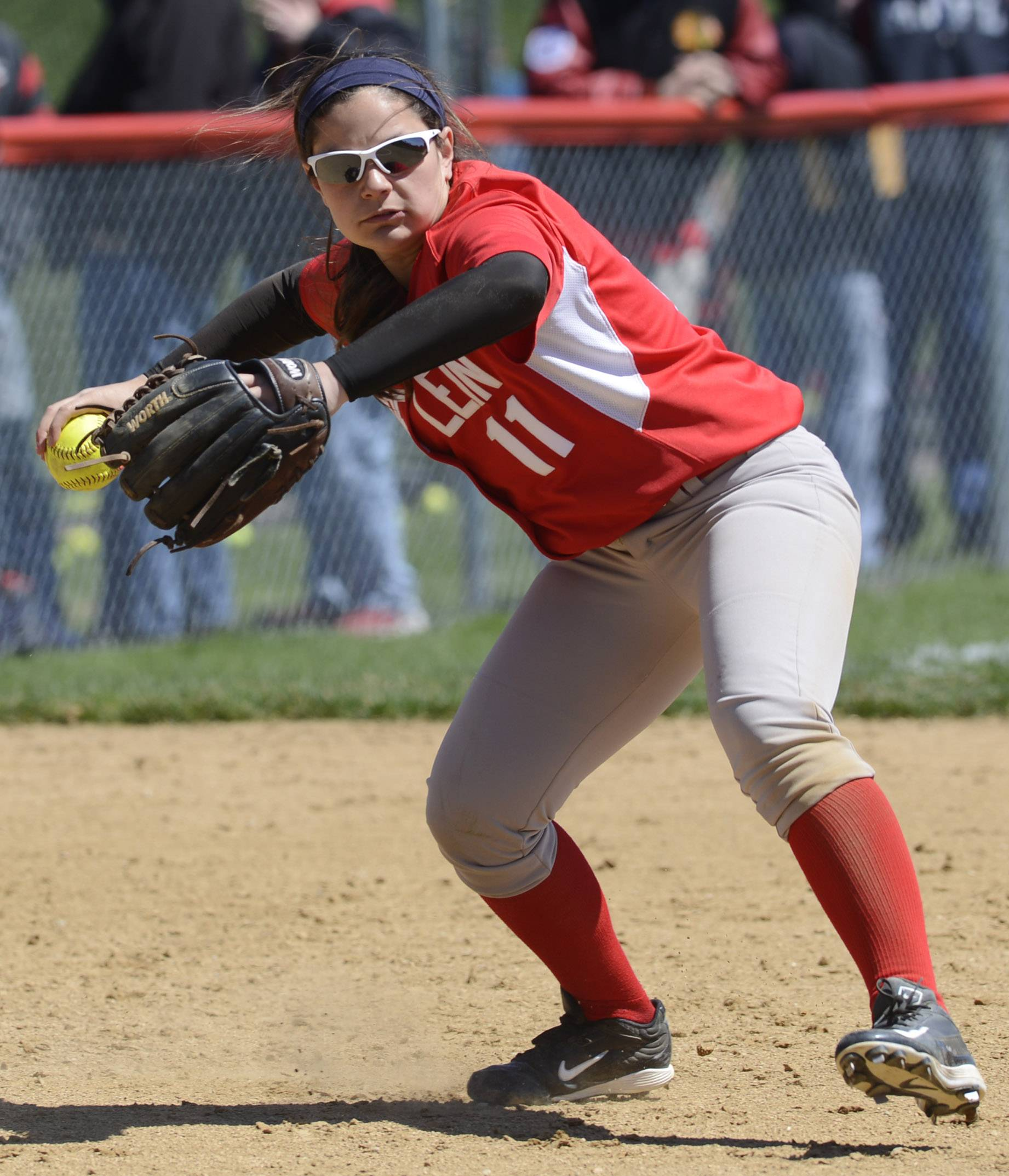 Mundelein third baseman Maria DeVito makes a throw to first during Game 1 of Saturday's doubleheader with Hersey.