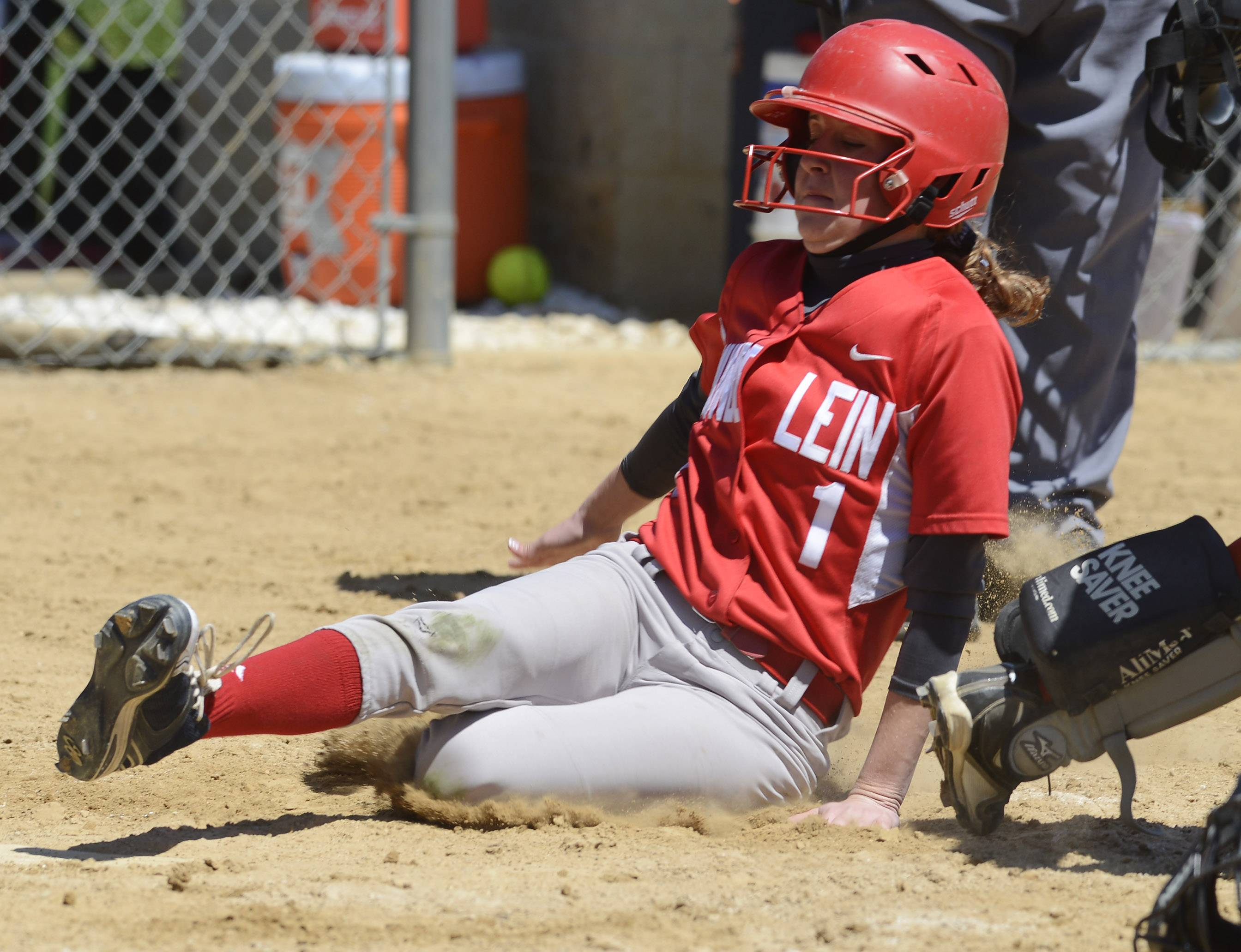 Mundelein's Danielle Beelow scores the go-ahead run during Saturday's game against Hersey,