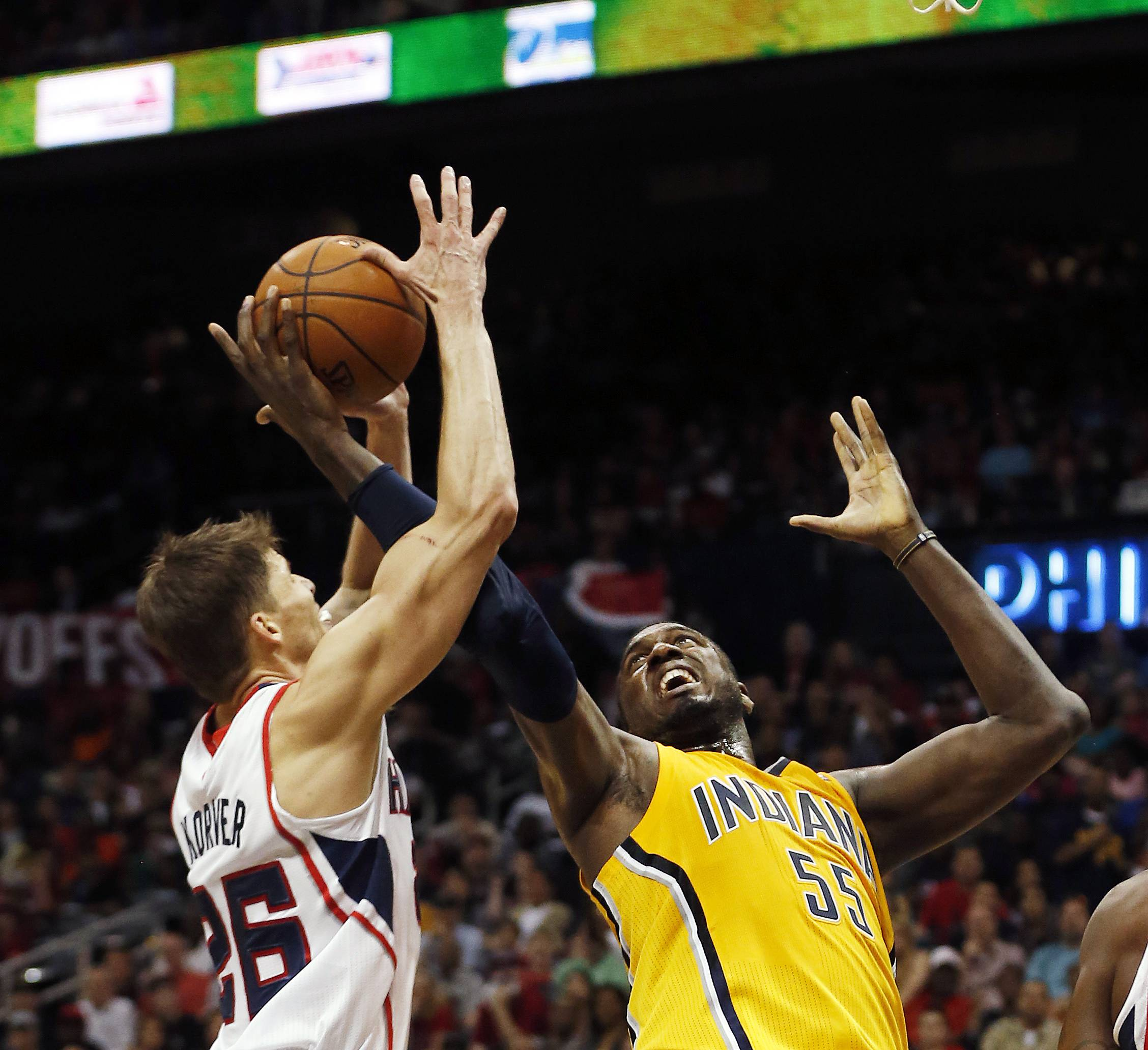 Atlanta Hawks guard Kyle Korver, left, and Indiana Pacers center Roy Hibbert (55) battle for the rebound in the first half of Game 4 of an NBA basketball first-round playoff series, Saturday, April 26, 2014, in Atlanta.