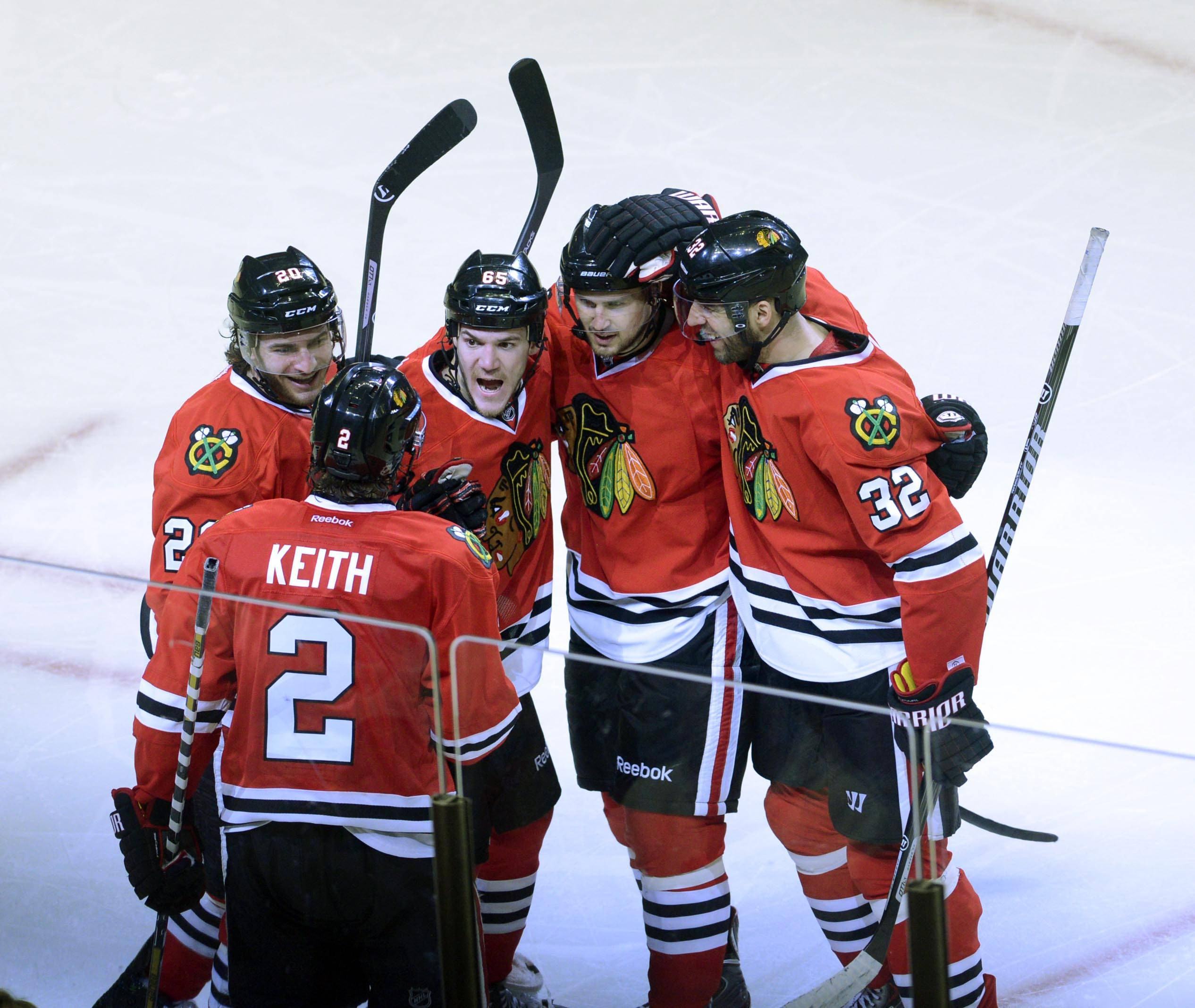 Chicago Blackhawks center Andrew Shaw is surrounded by teammates after his third-period goal against the St. Louis Blues Sunday in Game 6 of the NHL first round playoffs at the United Center in Chicago.