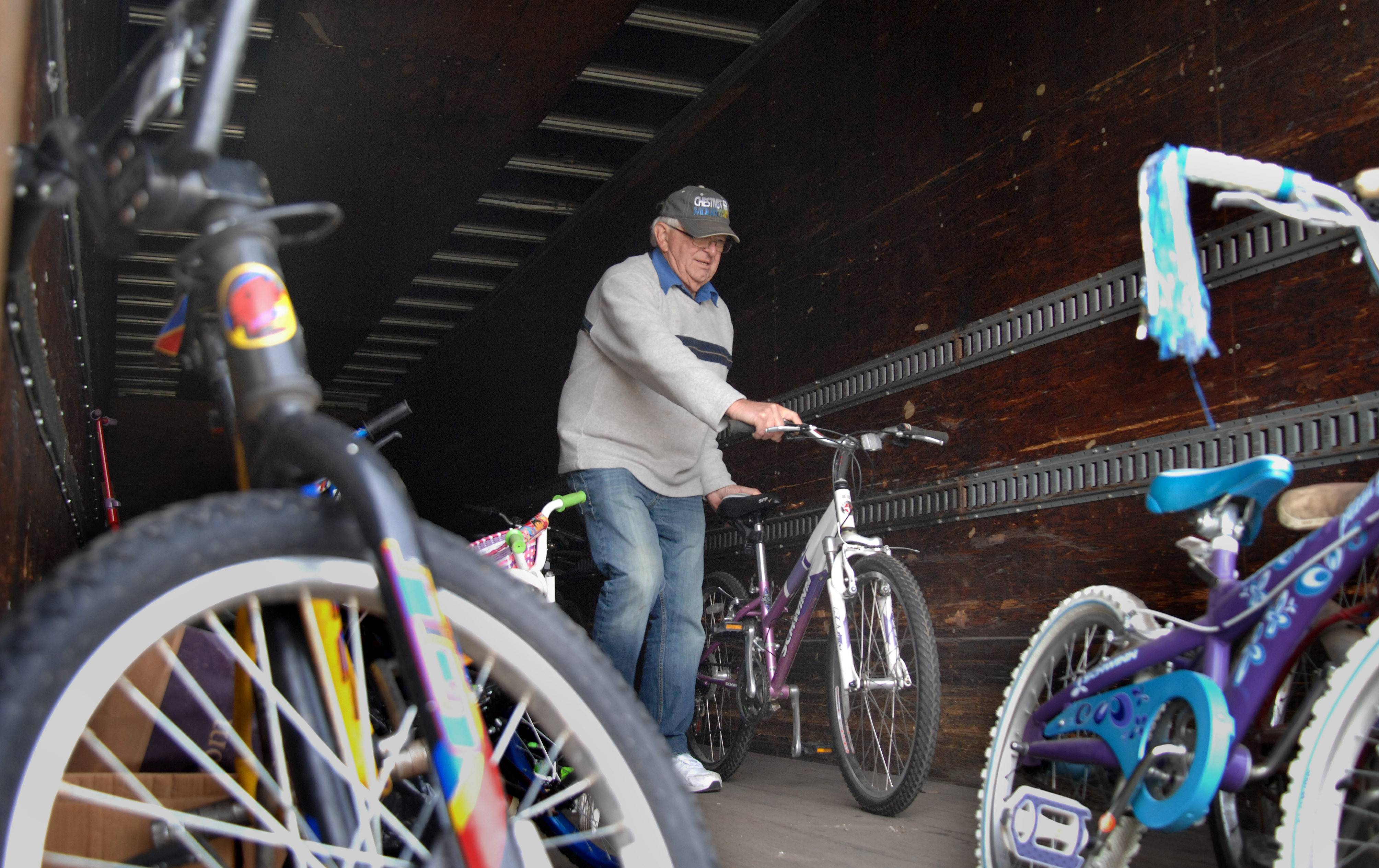 "Max Heide of Sycamore sorts donated bikes during the ""Bikes for Tikes"" drive Sunday at Hosanna! Lutheran Church in St. Charles. After being cleaned and tuned, the bikes will be given to students from Golfview Elementary School in Carpentersville."