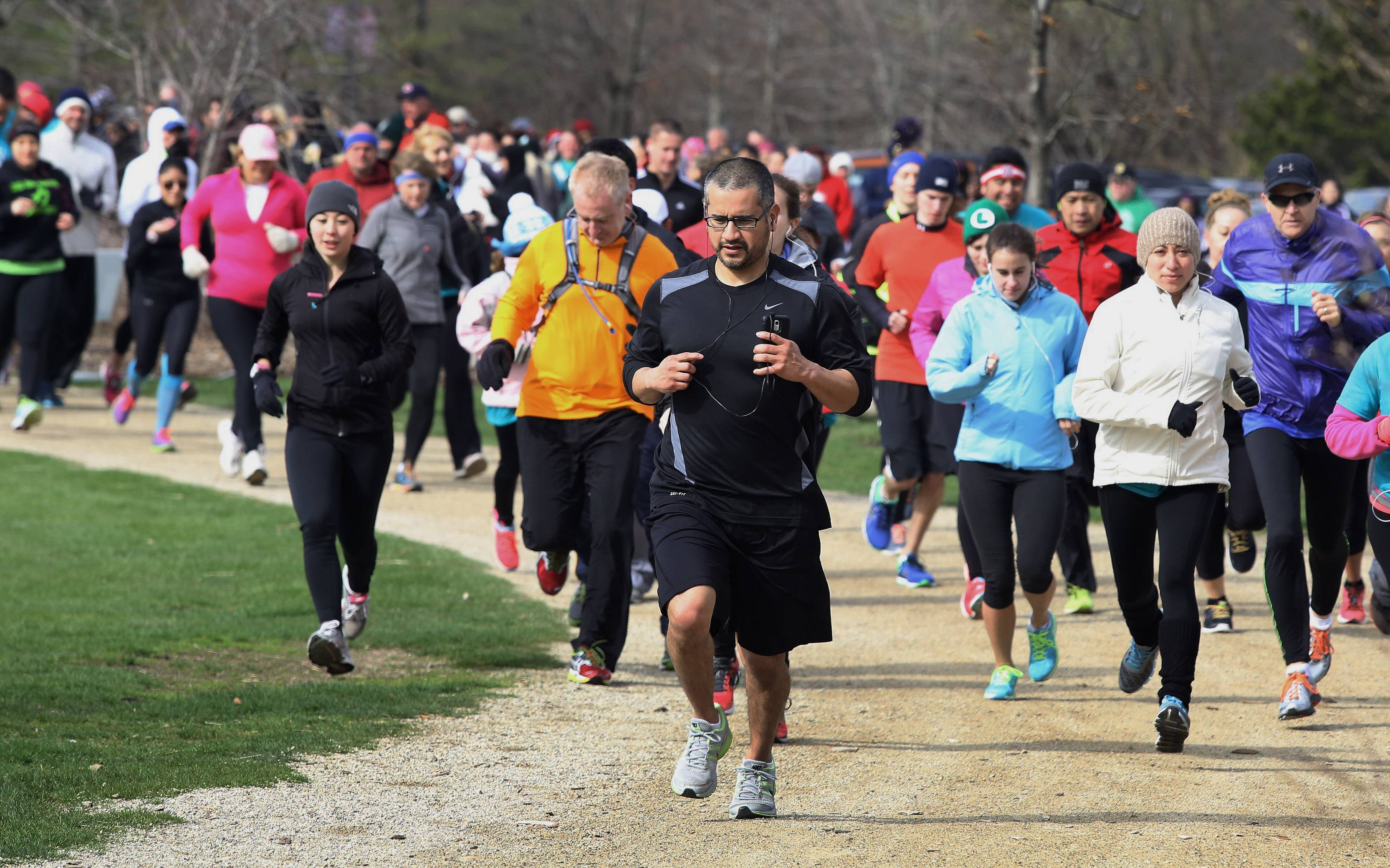 "Racers take off from the starting line of the second annual Zacharias Sexual Abuse Center 5K Run/Walk Sunday at Independence Grove Forest Preserve near Libertyville. More than 300 people attended the fundraising event called ""From Here To Healing."""