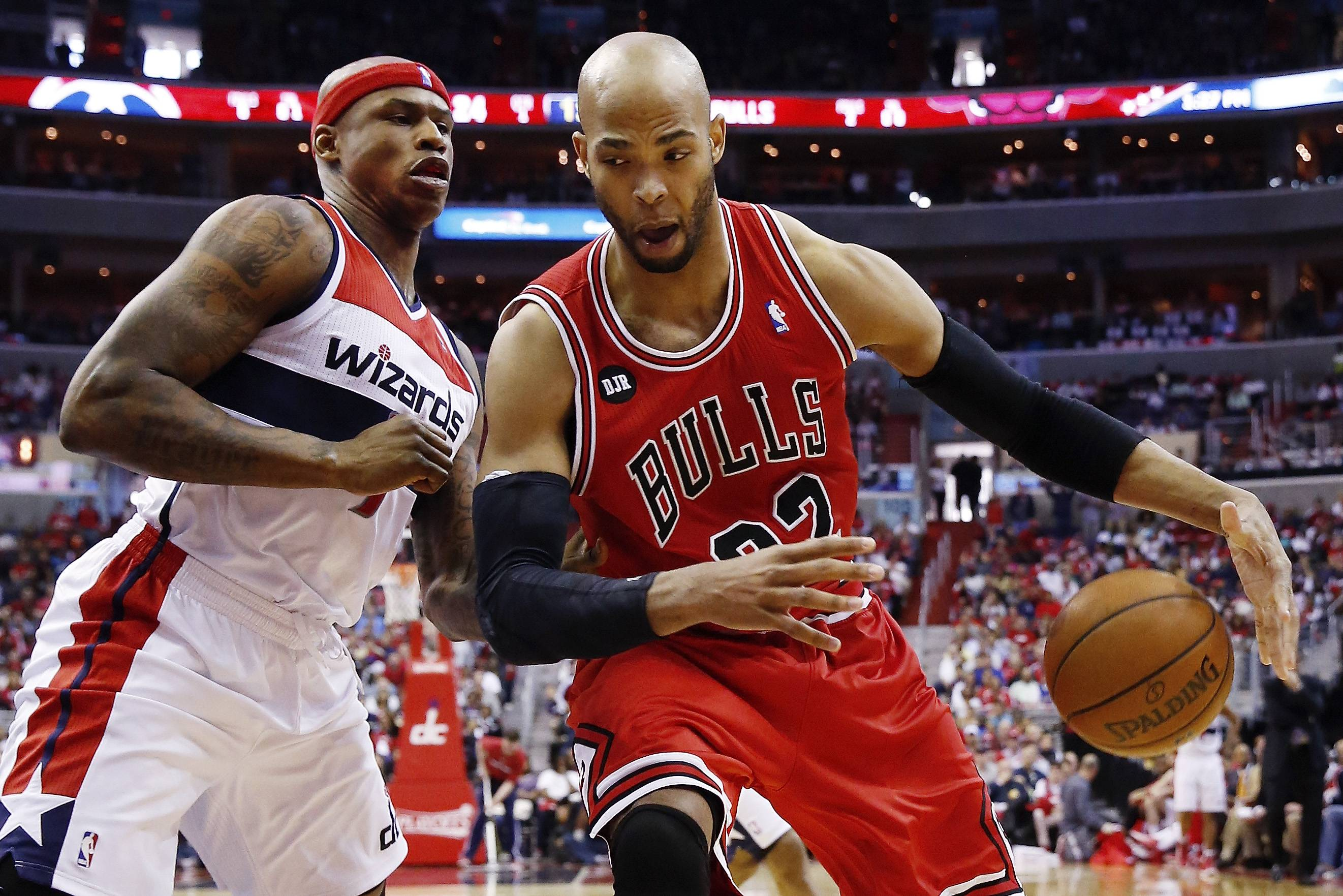 Bulls forward Taj Gibson drives past the Wizards' Al Harrington on his way to 32 points in 32 minutes off the bench in Sunday's loss at Washington.