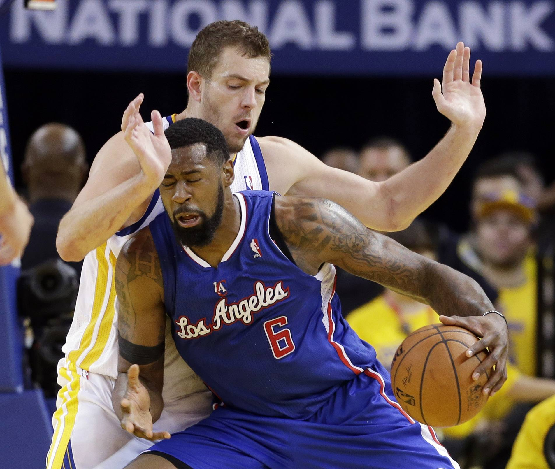 Los Angeles Clippers' DeAndre Jordan (6) is defended by Golden State Warriors' David Lee during the second half in Game 4 of an opening-round NBA basketball playoff series on Sunday, April 27, 2014, in Oakland, Calif. Golden State won 118-97.