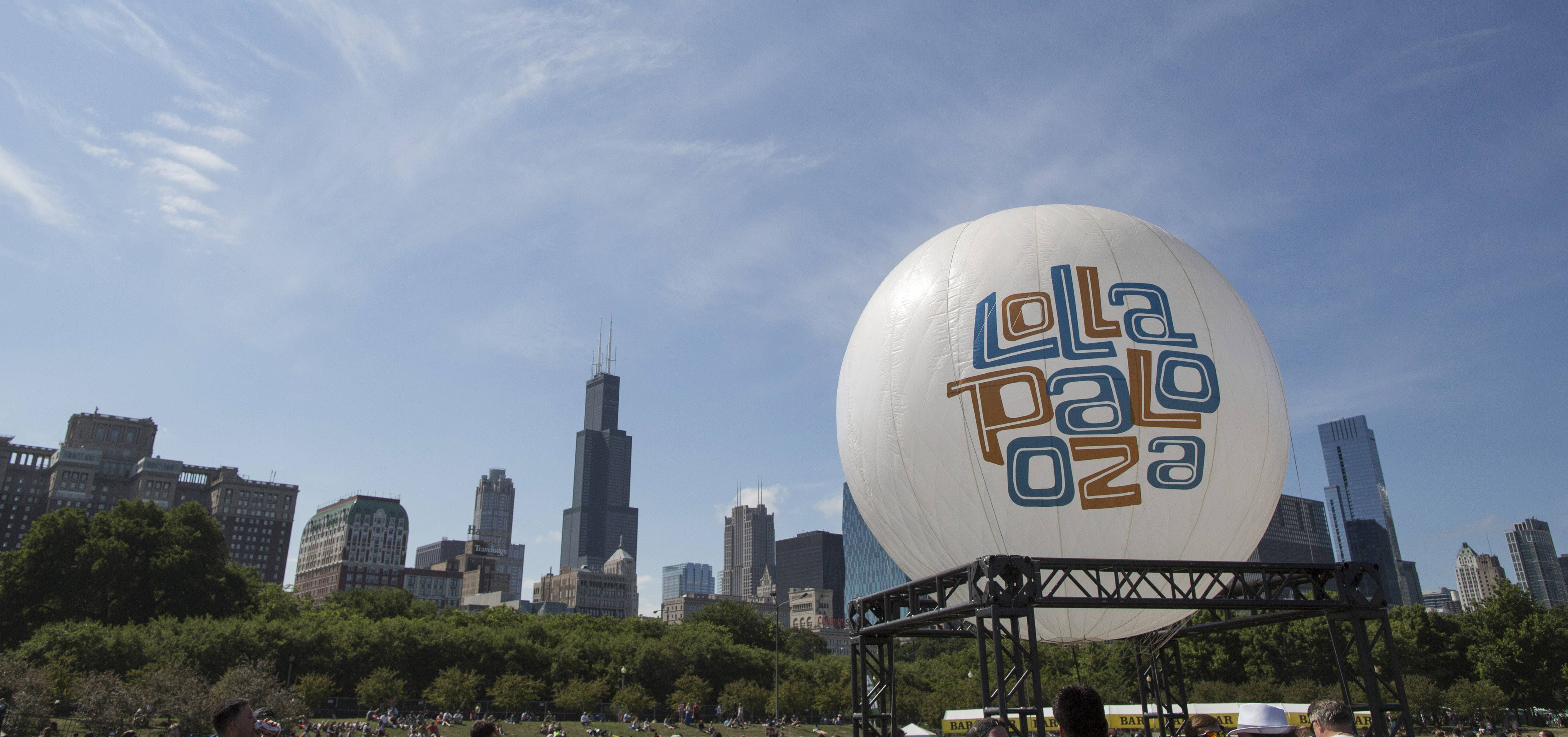 A Lollapalooza balloon floats between stages at the Lollapalooza Festival in Chicago. The 2014 season of music festivals is upon us. It's easy to get caught up in the excitement and spend a bundle, on everything from tickets to accommodations to bottles of water. But with a little foresight, it's easy to cut down on excess spending and enjoy the music and excitement without breaking the bank.