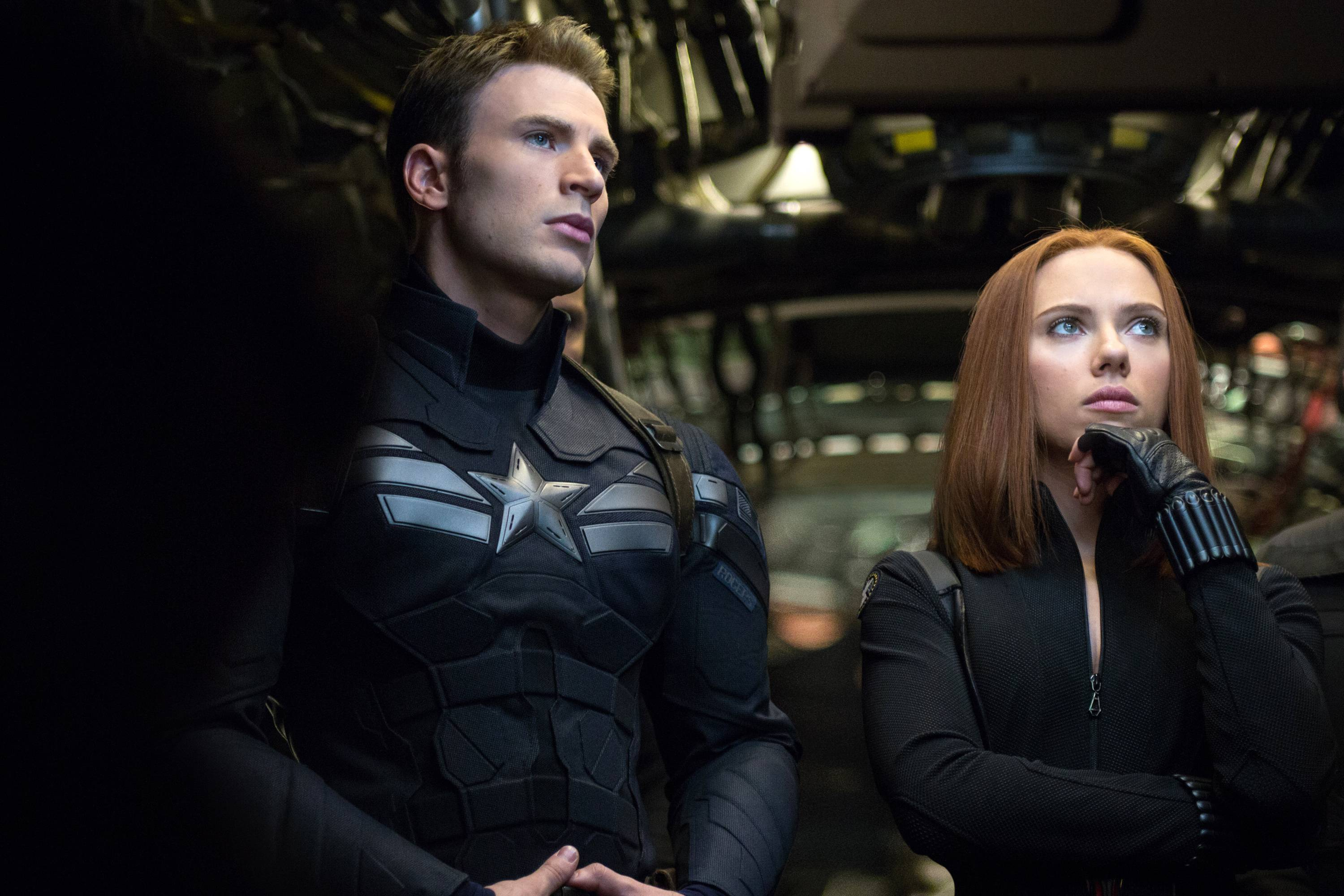 "This image released by Marvel shows Chris Evans, left, and Scarlett Johansson in a scene from ""Captain America: The Winter Soldier."""