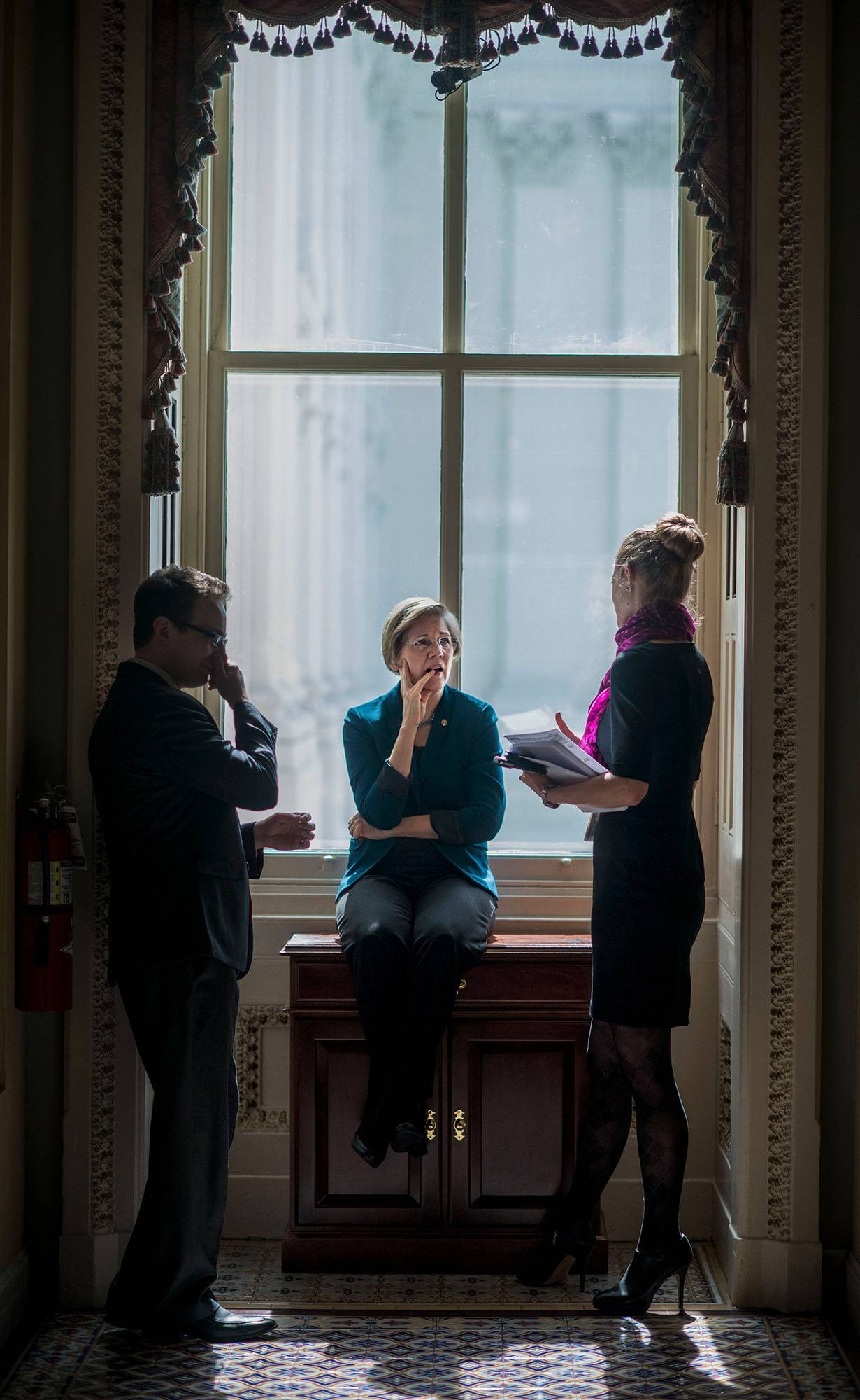 "Senator Elizabeth Warren, D-Mass., speaks to staff before Senate policy luncheons on Capitol Hill in Washington in March; she has a new memoir out titled ""A Fighting Chance."""