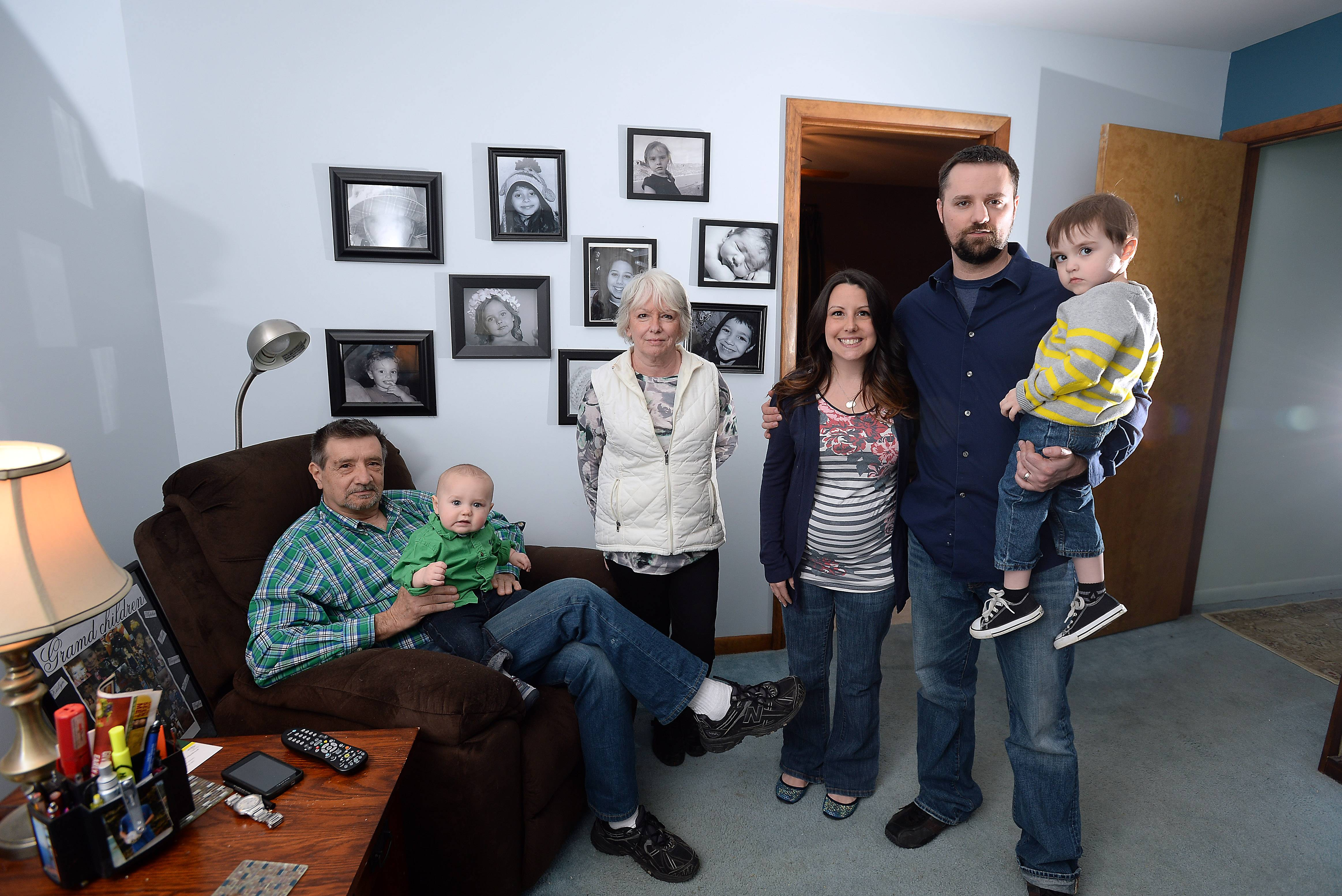 Teacher Matthew Dowd and his wife Lynn, at right with son Grayson, purchased a home so that Lynn's parents, Robert and Patricia Pagni, left, could live with them. Robert holds grandson Griffin.