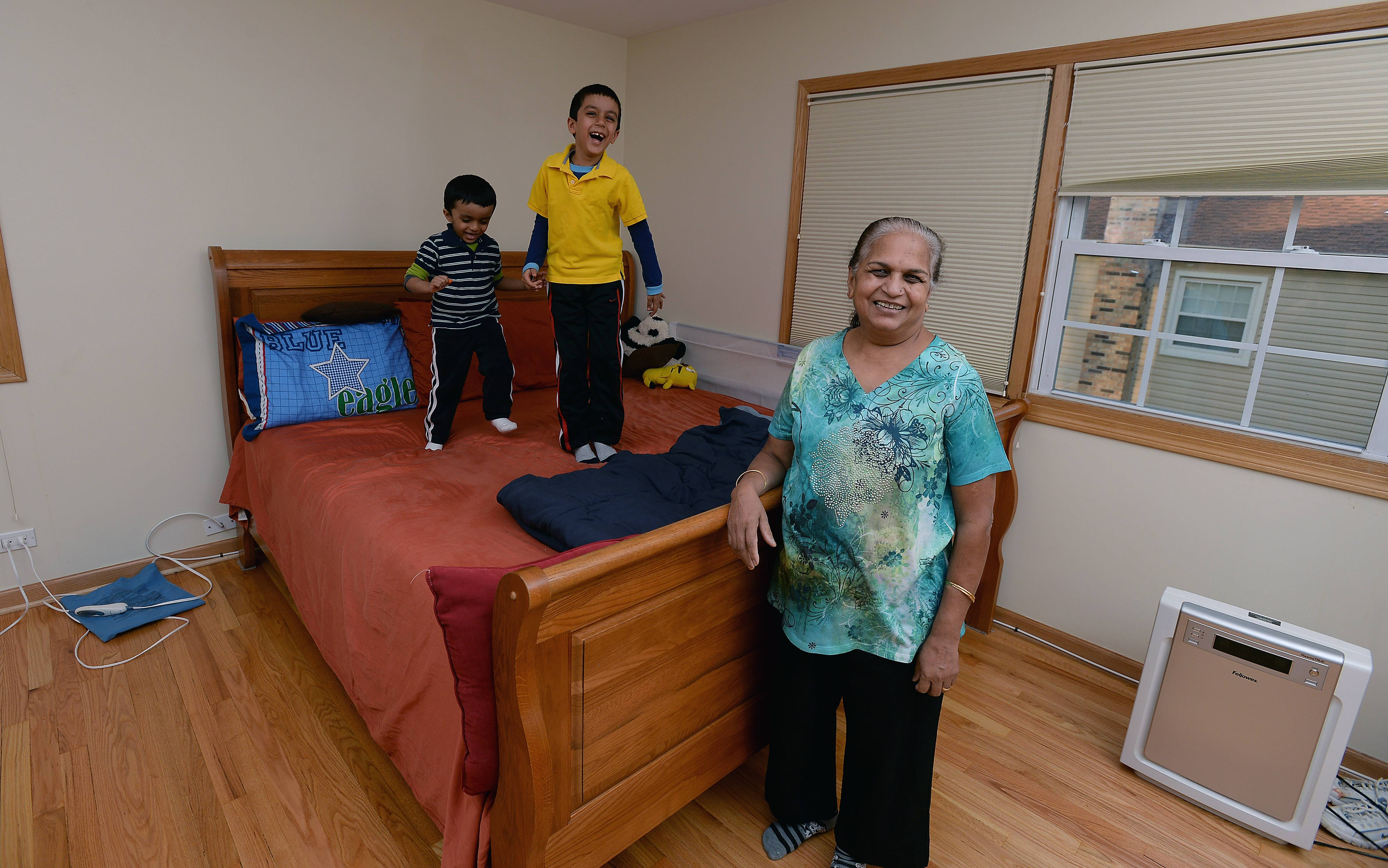Lili Patel of Mount Prospect enjoys living with and helping to care for her grandchildren,  Raveen, 6, and Jushnn, 4