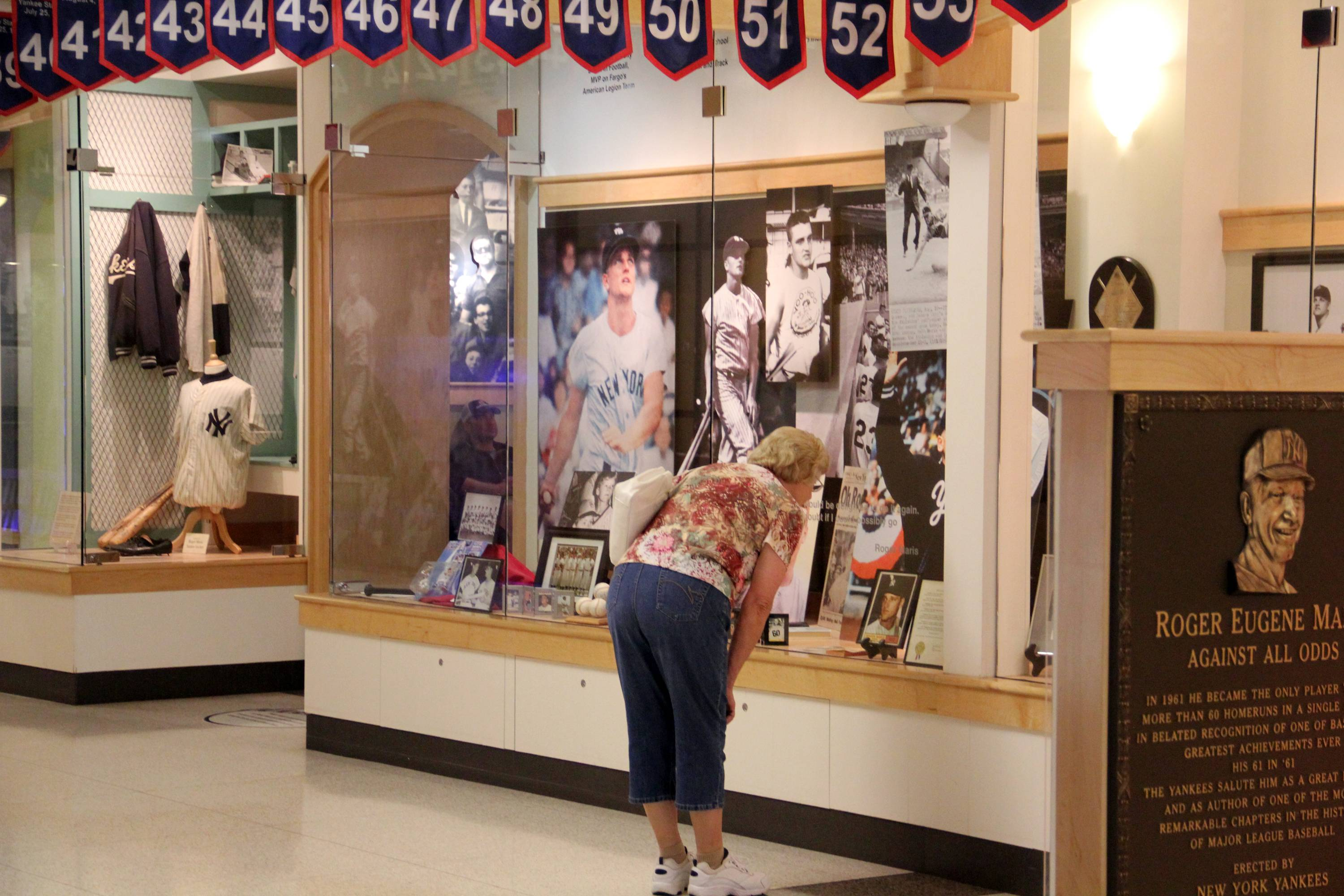 A woman looks at a display on baseball legend Roger Maris in the West Acres Mall in Fargo, N.D.