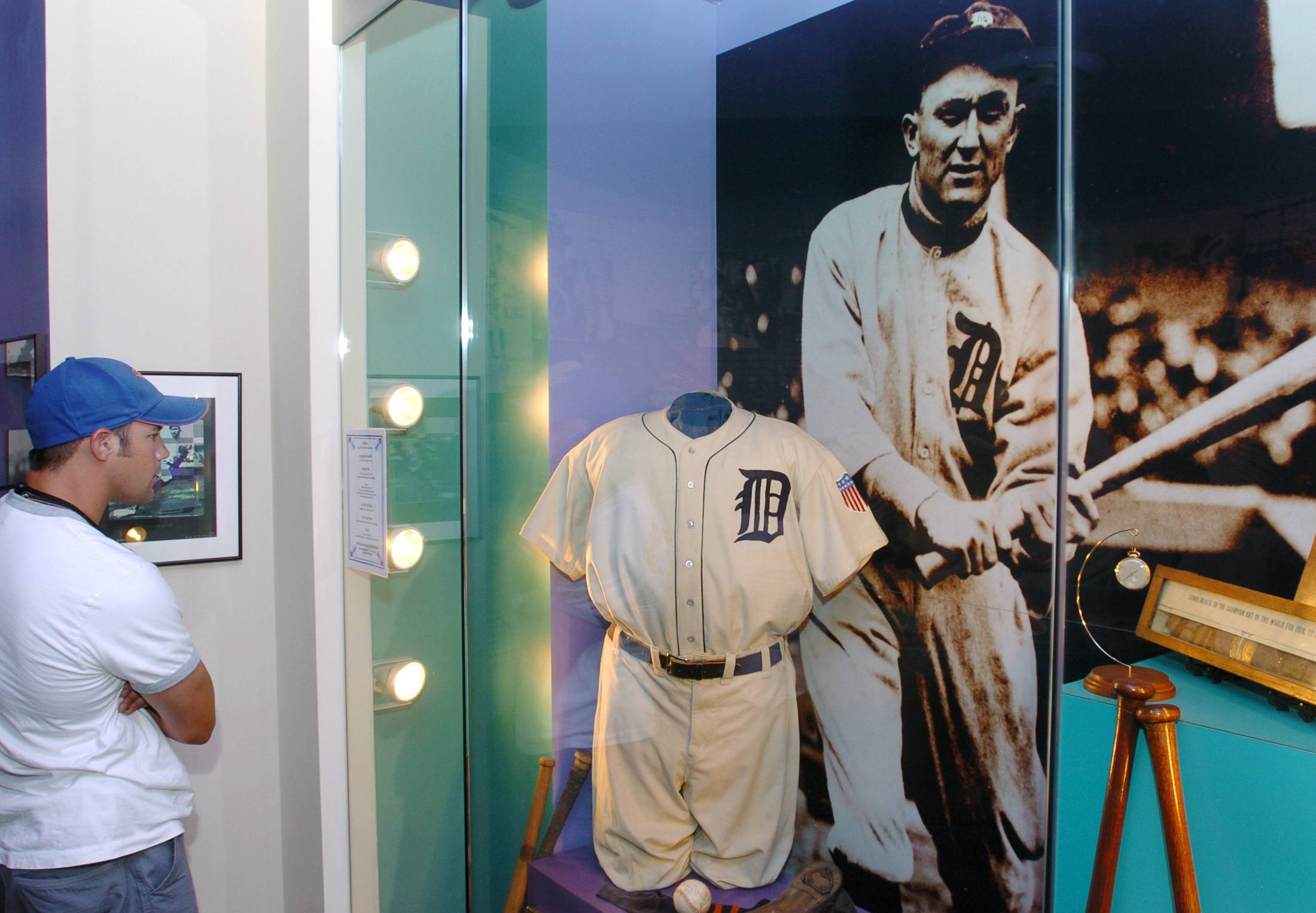 A fan looks at baseball memorabilia at the Ty Cobb Museum in Royston, Ga.