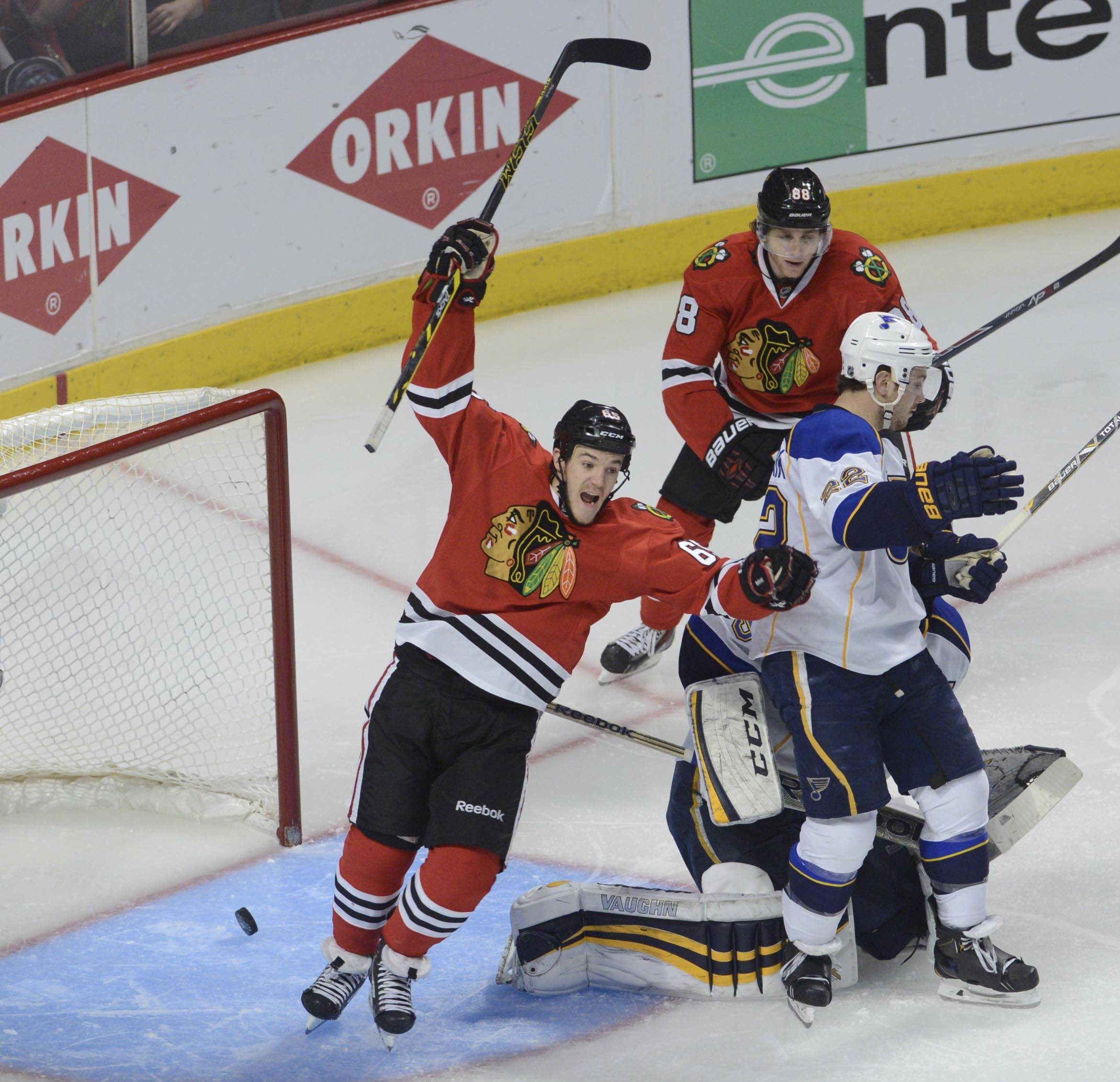 Chicago Blackhawks center Andrew Shaw celebrates teammate Jonathan Toews third period goal.