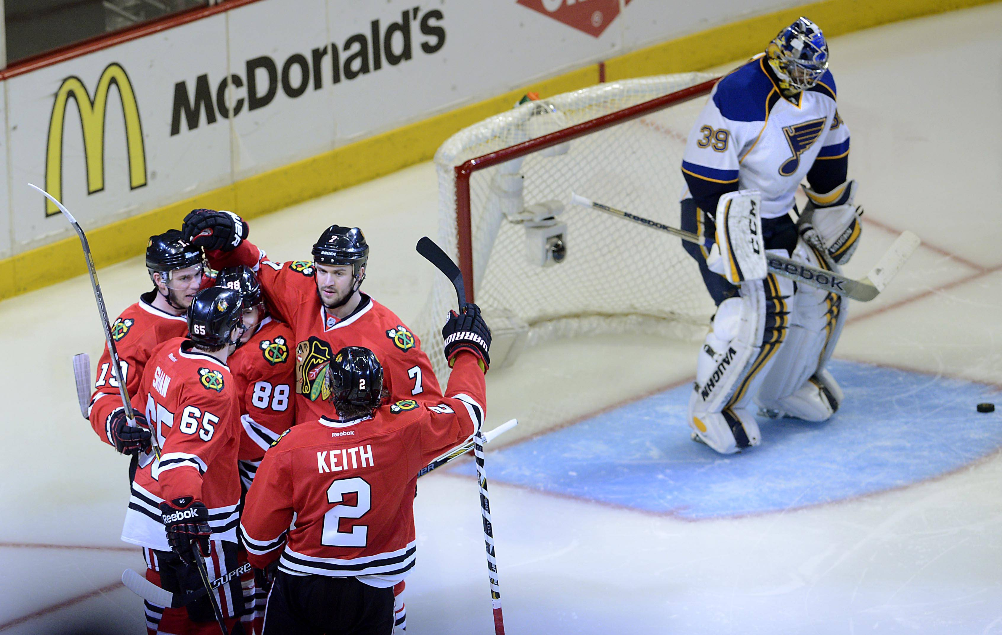 Chicago Blackhawks center Jonathan Toews, left, is surrounded by teammates after his third-period goal.