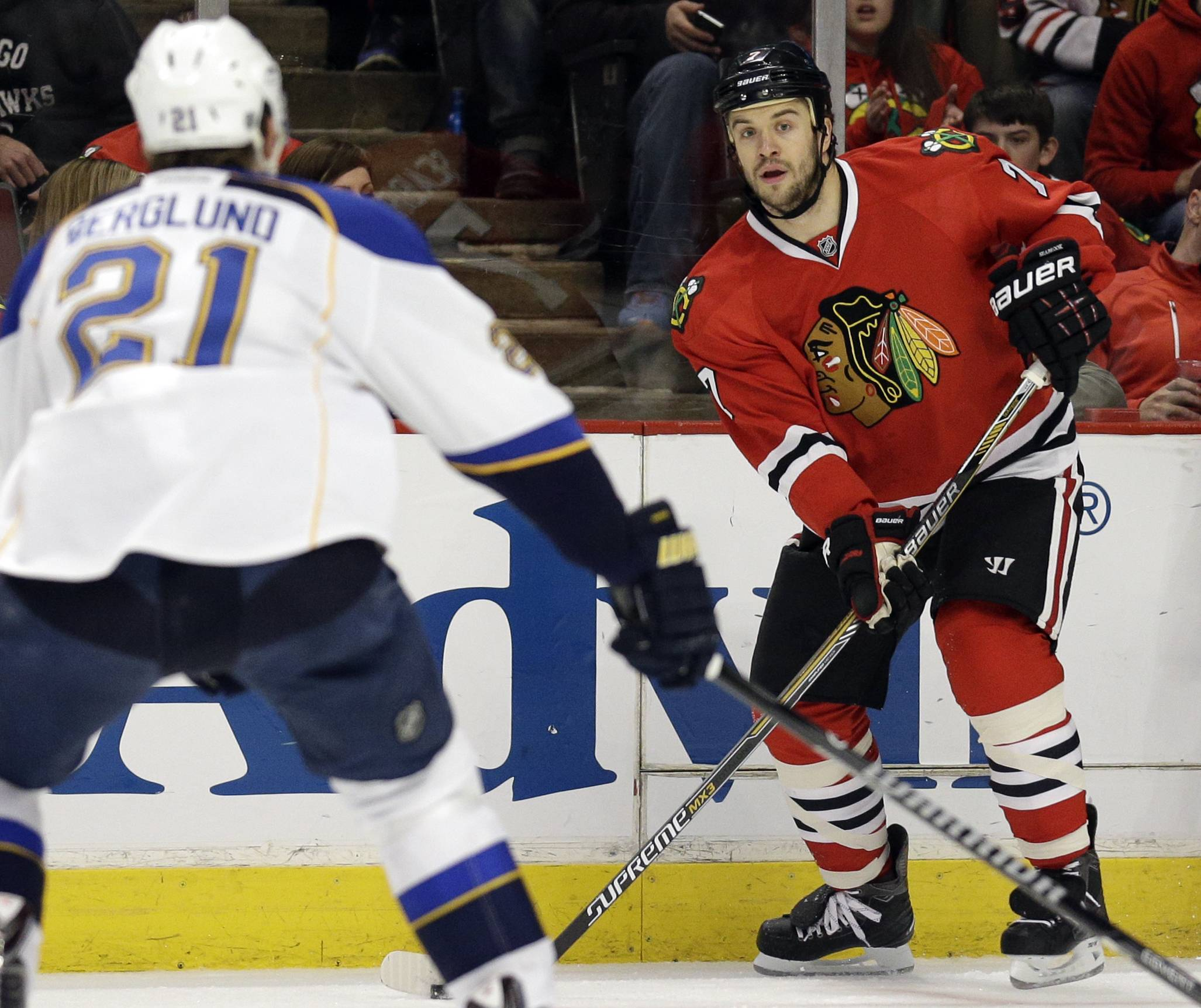 Chicago Blackhawks' Brent Seabrook, right, looks to a pass against St. Louis Blues' Patrik Berglund (21) during the first period.