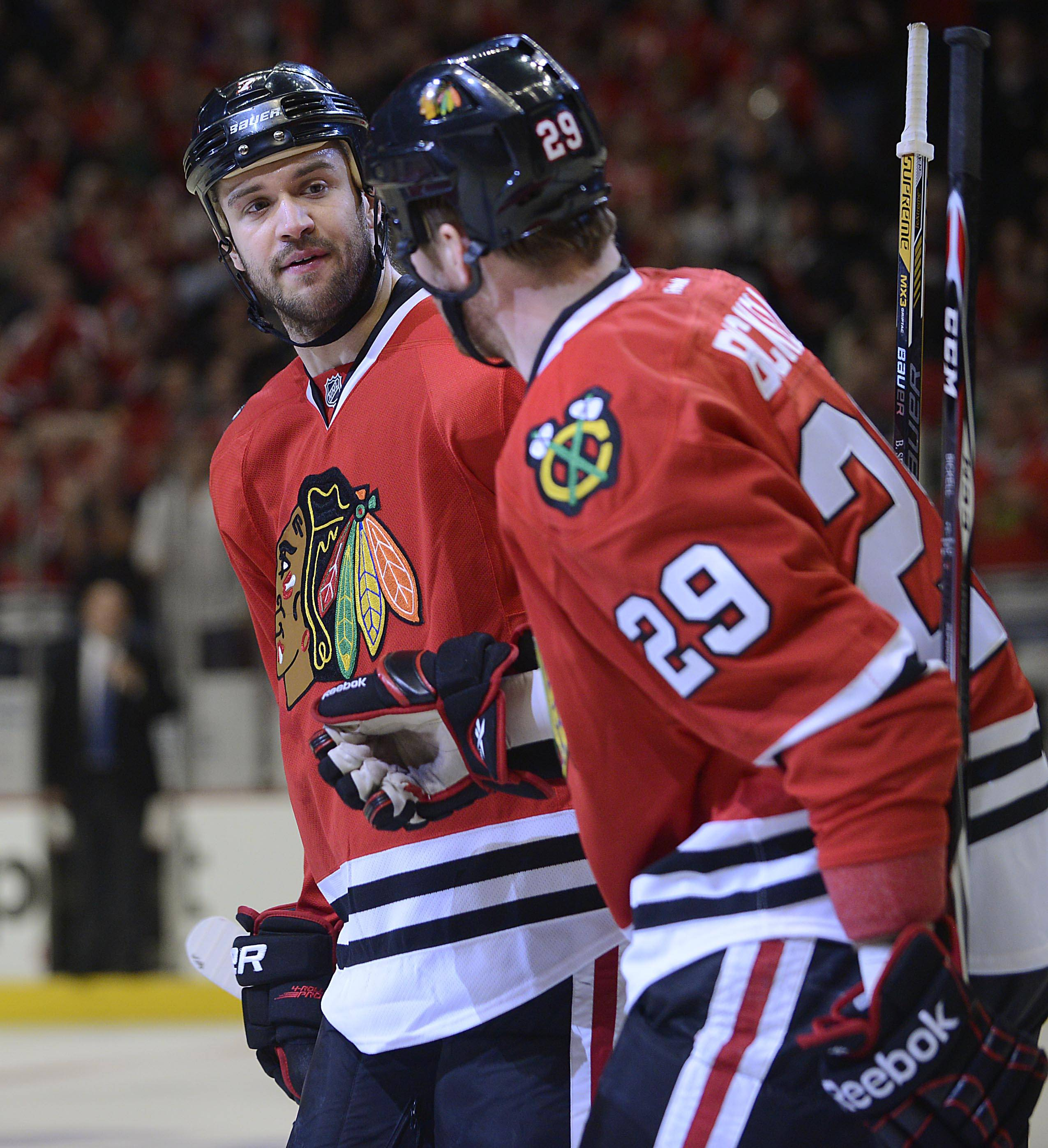 Chicago Blackhawks defenseman Duncan Keith smiles with teammate Bryan Bickell after Bickell's first-period goal against the St. Louis Blues Sunday in Game 6 of the NHL first round playoffs at the United Center in Chicago.