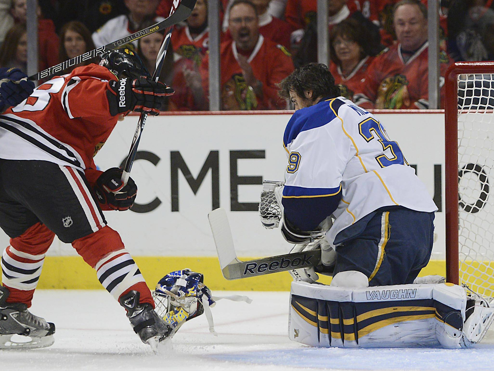 St. Louis Blues goalie Ryan Miller's helmet is knocked off in the first period Sunday in Game 6 of the NHL first round playoffs at the United Center in Chicago.
