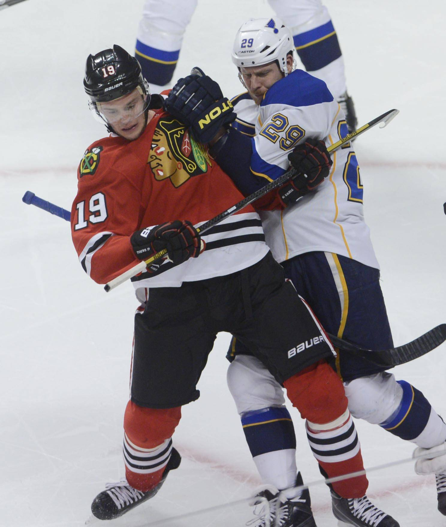 Chicago Blackhawks center Jonathan Toews is held by St. Louis Blues center Steve Ott Sunday in Game 6 of the NHL first round playoffs at the United Center in Chicago.