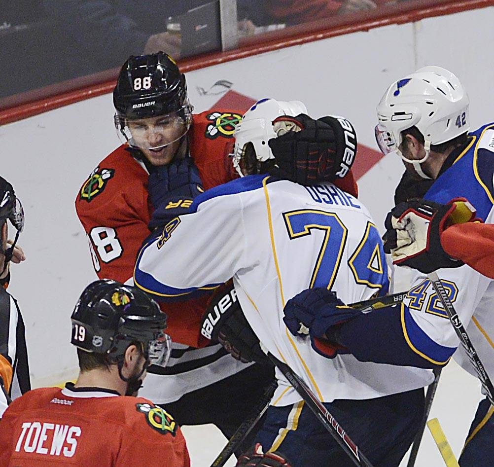Chicago Blackhawks right wing Patrick Kane is shoved by St. Louis Blues right wing T.J. Oshie Sunday in Game 6 of the NHL first round playoffs at the United Center in Chicago.