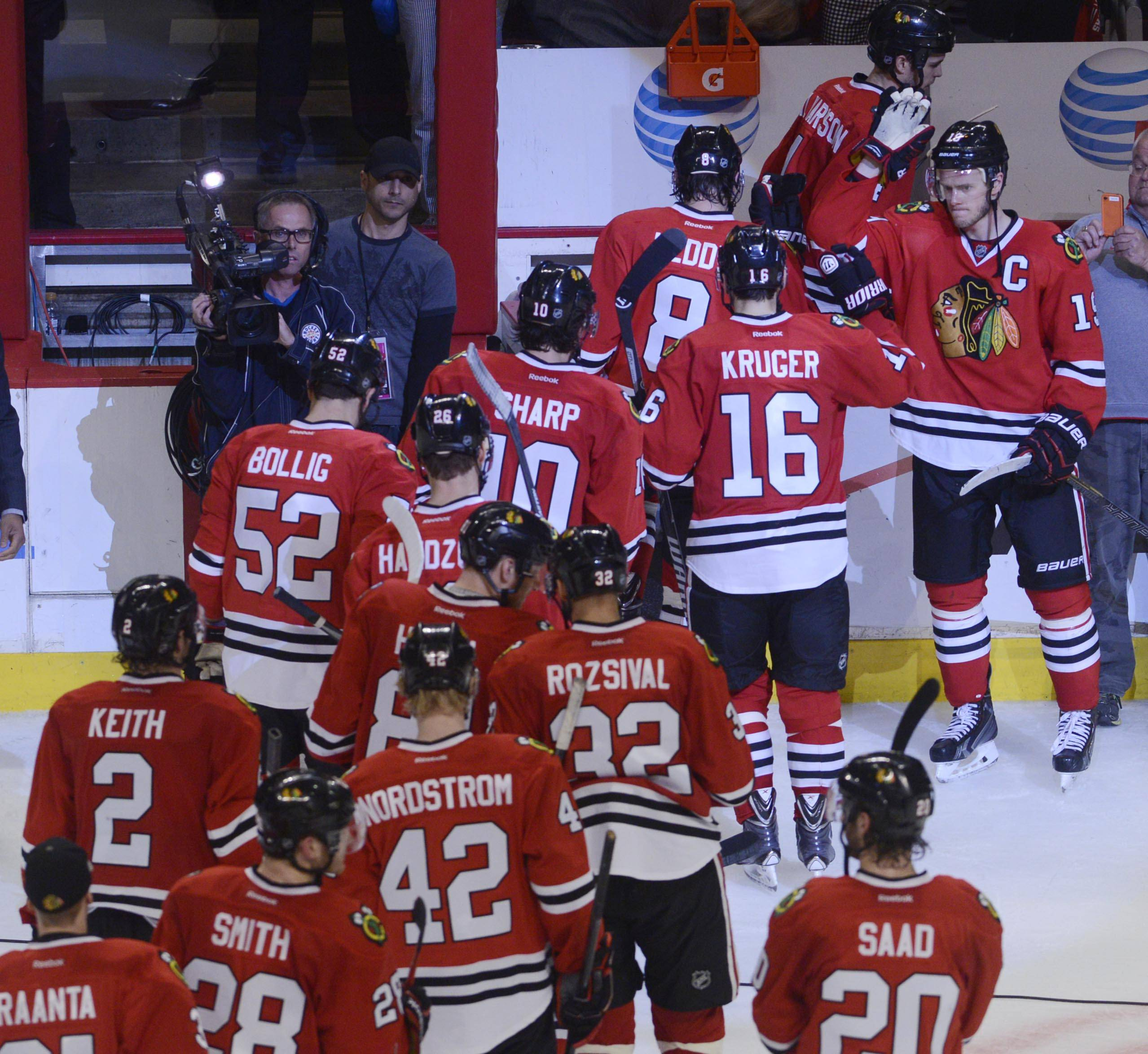 Chicago Blackhawks captain Jonathan Toews congratulates his teammates Sunday after they defeated the St. Louis Blues in Game 6 of the NHL first round playoffs.