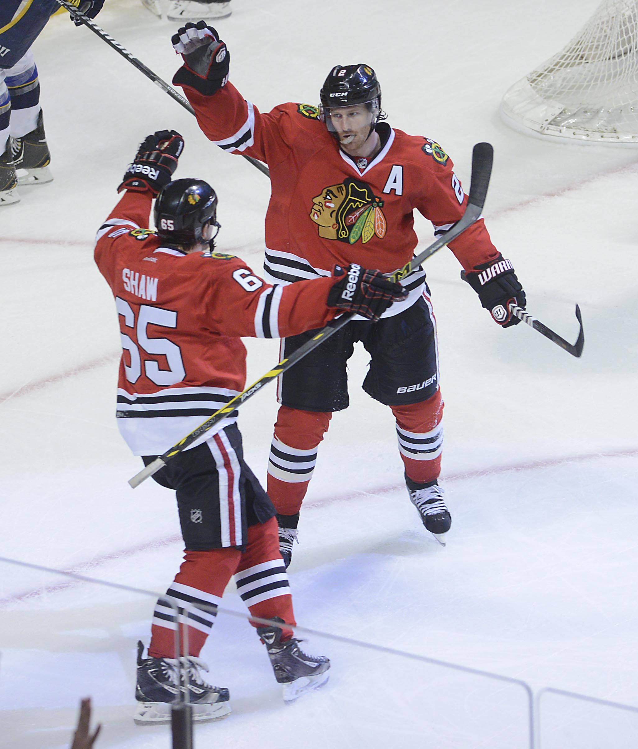 Chicago Blackhawks defenseman Duncan Keith turns to greet teammate Andrew Shaw after Shaw assisted in Keith's third-period goal to beat the St. Louis Blues 5-1 Sunday in Game 6.