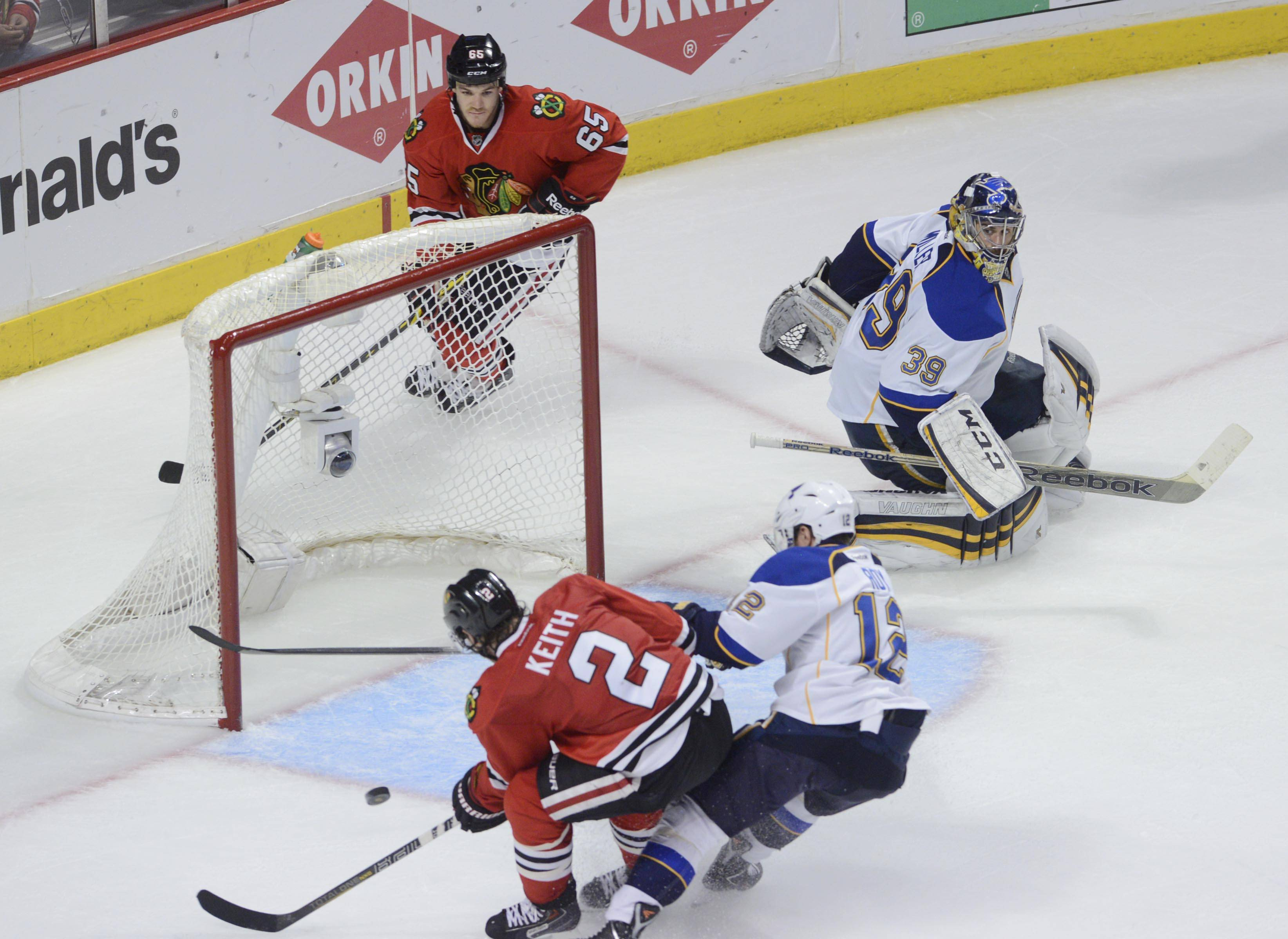 Chicago Blackhawks defenseman Duncan Keith shoots to score after a pass from teammate Andrew Shaw, bend the net, in the third period to make the final score 5-1 against the St. Louis Blues.