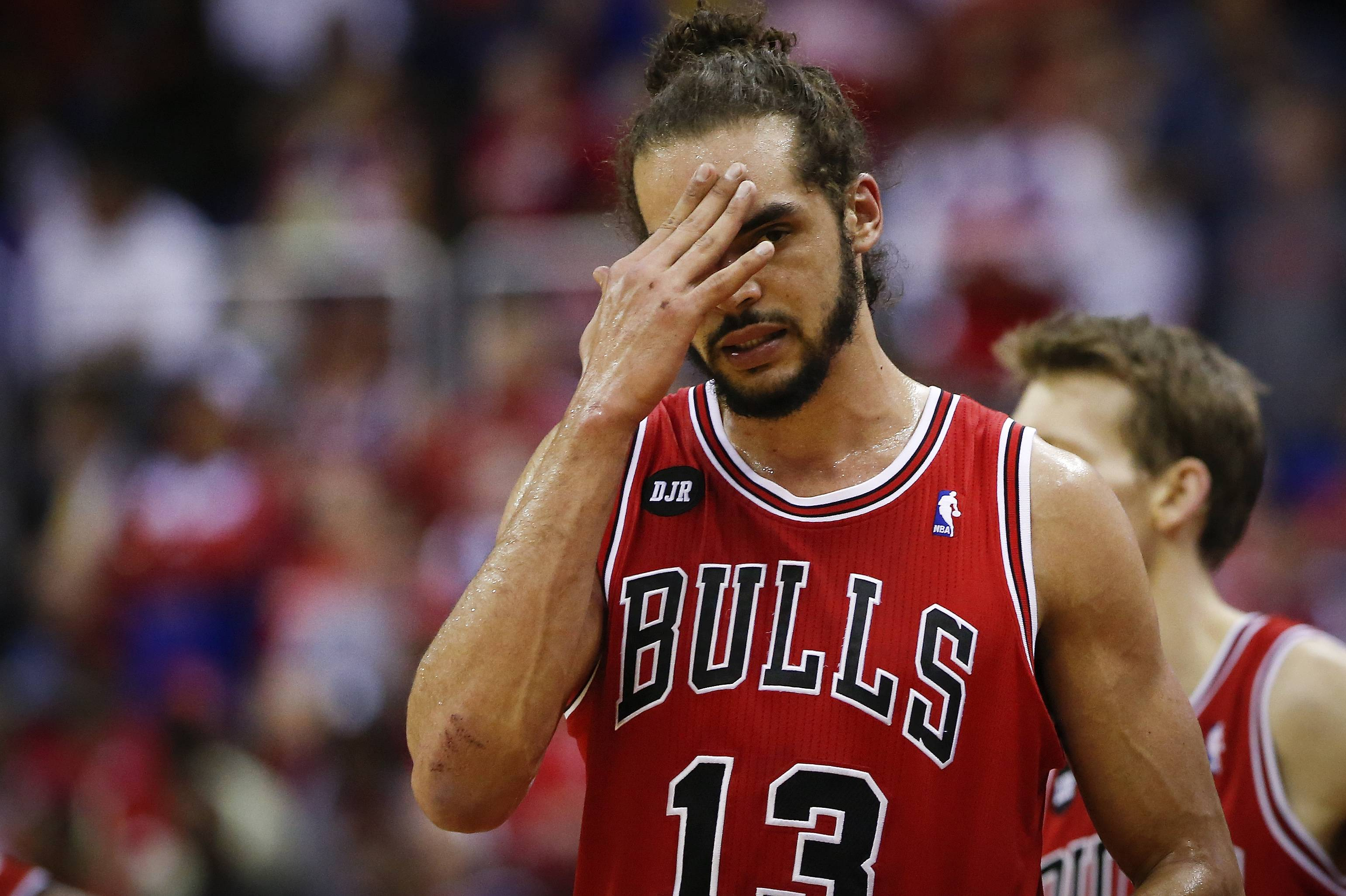Chicago Bulls center Joakim Noah (13) holds his hand to his head during a break in the action against the Washington Wizards during the first half of Game 4 of an opening-round NBA basketball playoff series in Washington, Sunday, April 27, 2014.