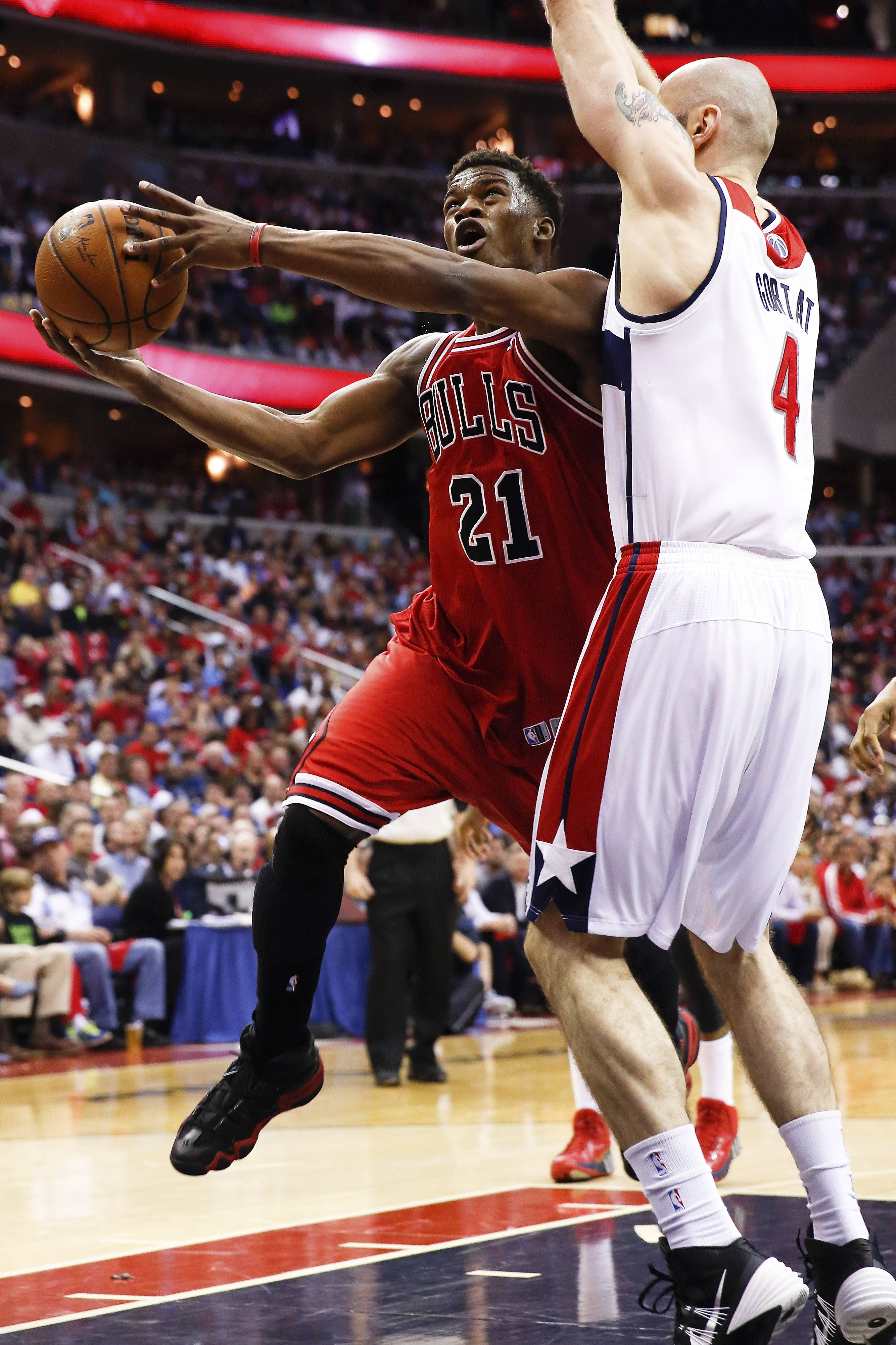 Chicago Bulls guard Jimmy Butler (21) looks for a way around Washington Wizards center Marcin Gortat (4), from Poland, during the first half.