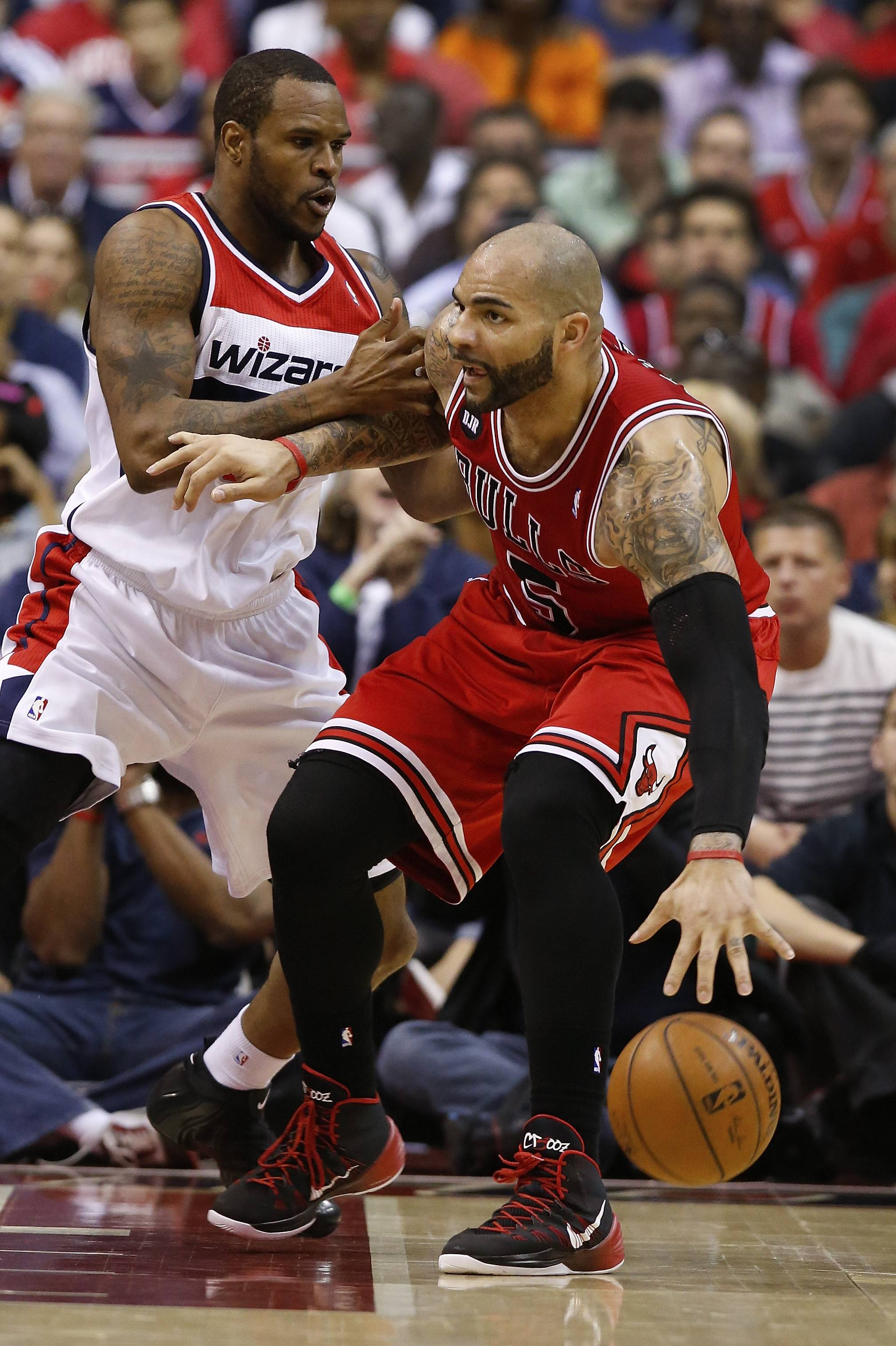 Chicago Bulls forward Carlos Boozer (5) drives past Washington Wizards forward Trevor Booker (35) during the second half.