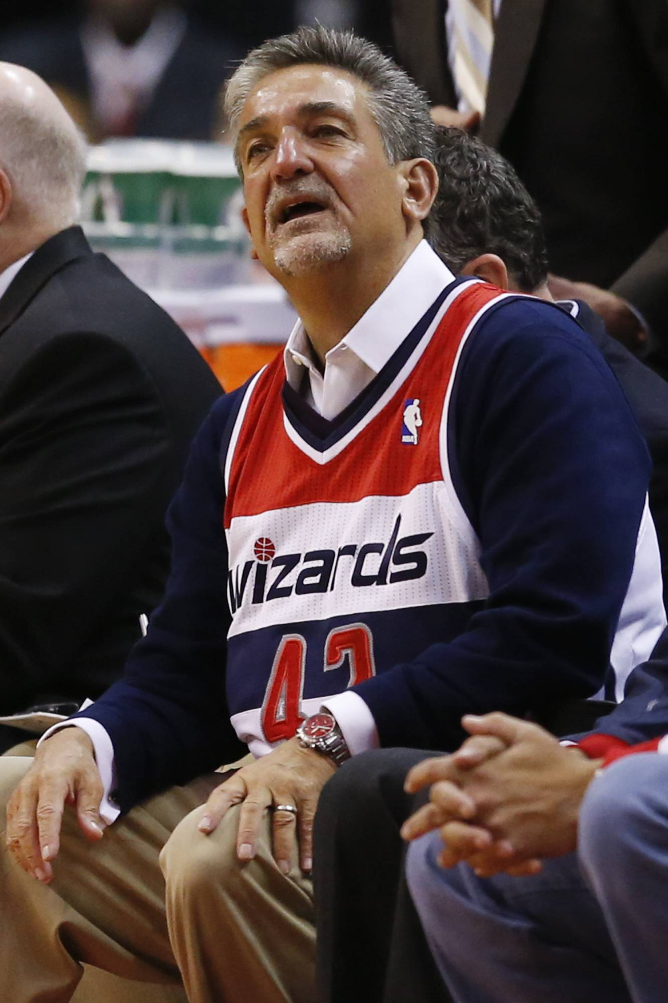 Washington Wizards owner Ted Leonsis, while sitting on the bench wearing Wizards forward Nene's jersey, watches the second half. Nene is serving a one-game suspension.