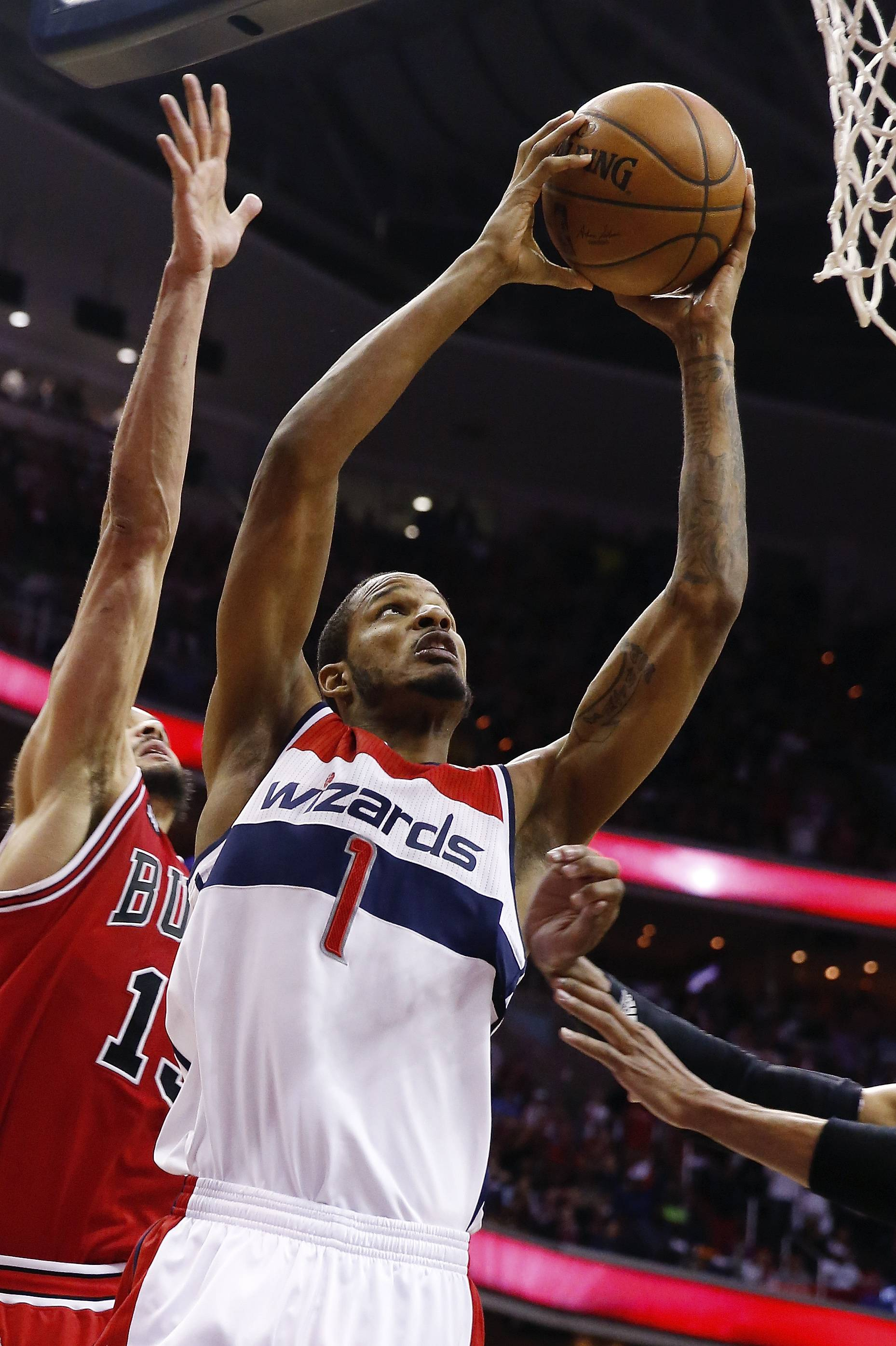 Washington Wizards forward Trevor Ariza (1) shots for two points under pressure from Chicago Bulls center Joakim Noah (13) during the second half. The Wizards defeated the Bulls 98-89.