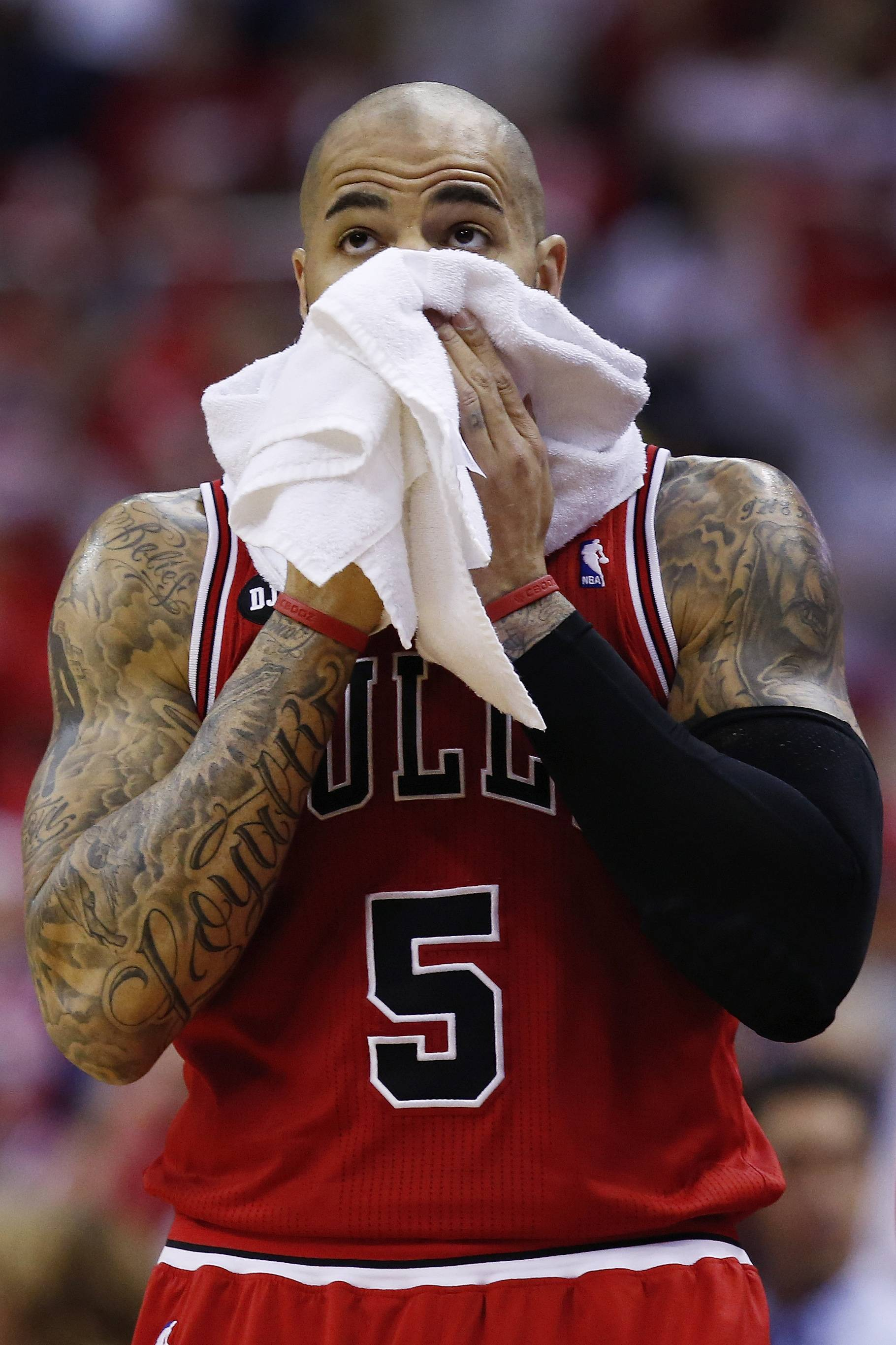 Chicago Bulls forward Carlos Boozer (5) looks at the scoreboard during the first half.