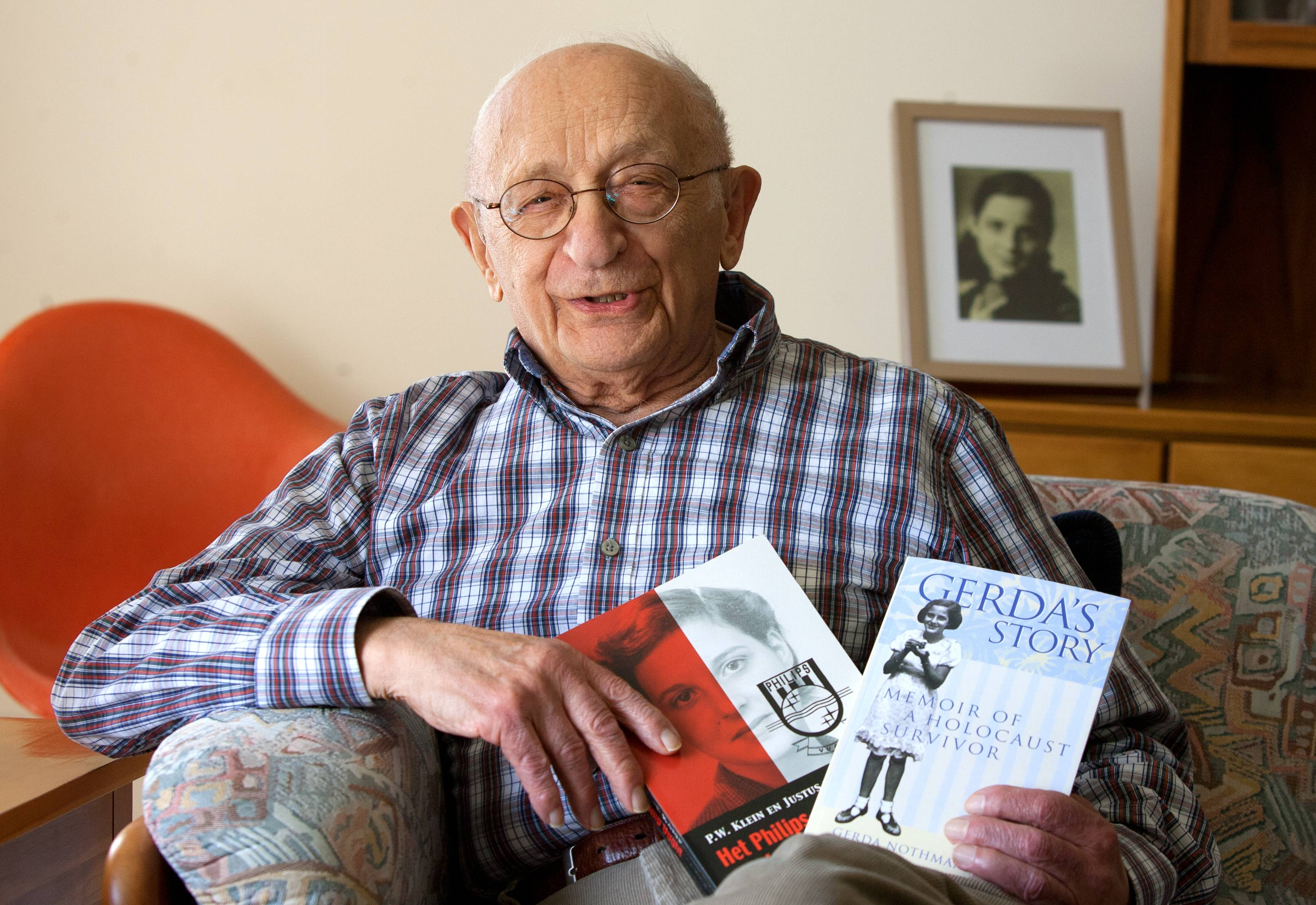 Holding books that tell how his late wife, Gerda Nothmann Luner, survived the Holocaust, Charles Luner has seen the book of letters he compiled performed as a stage play.