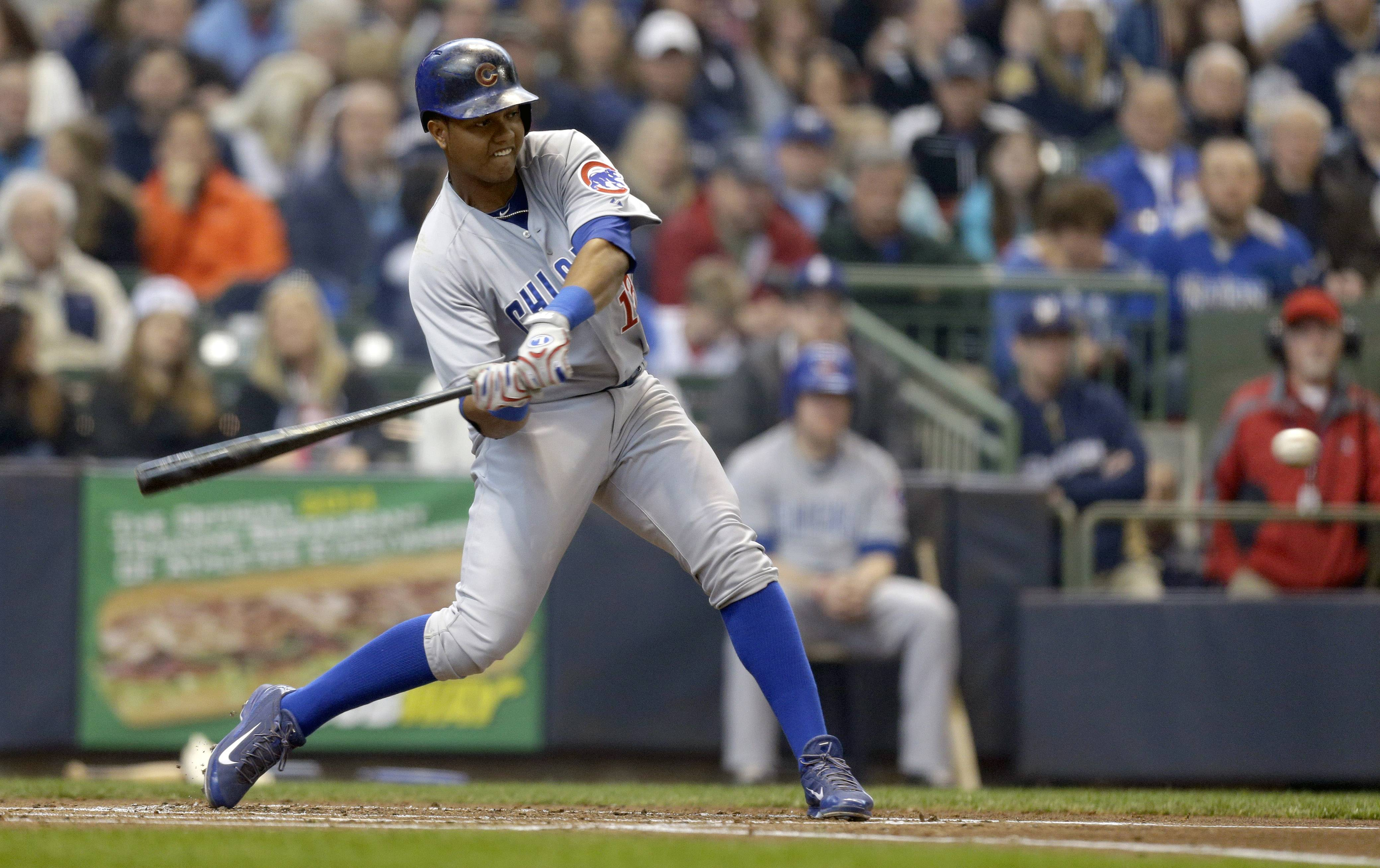 The Cubs' Starlin Castro hits 1 of his 2 home runs Sunday against the Brewers at Miller Park in Milwaukee.