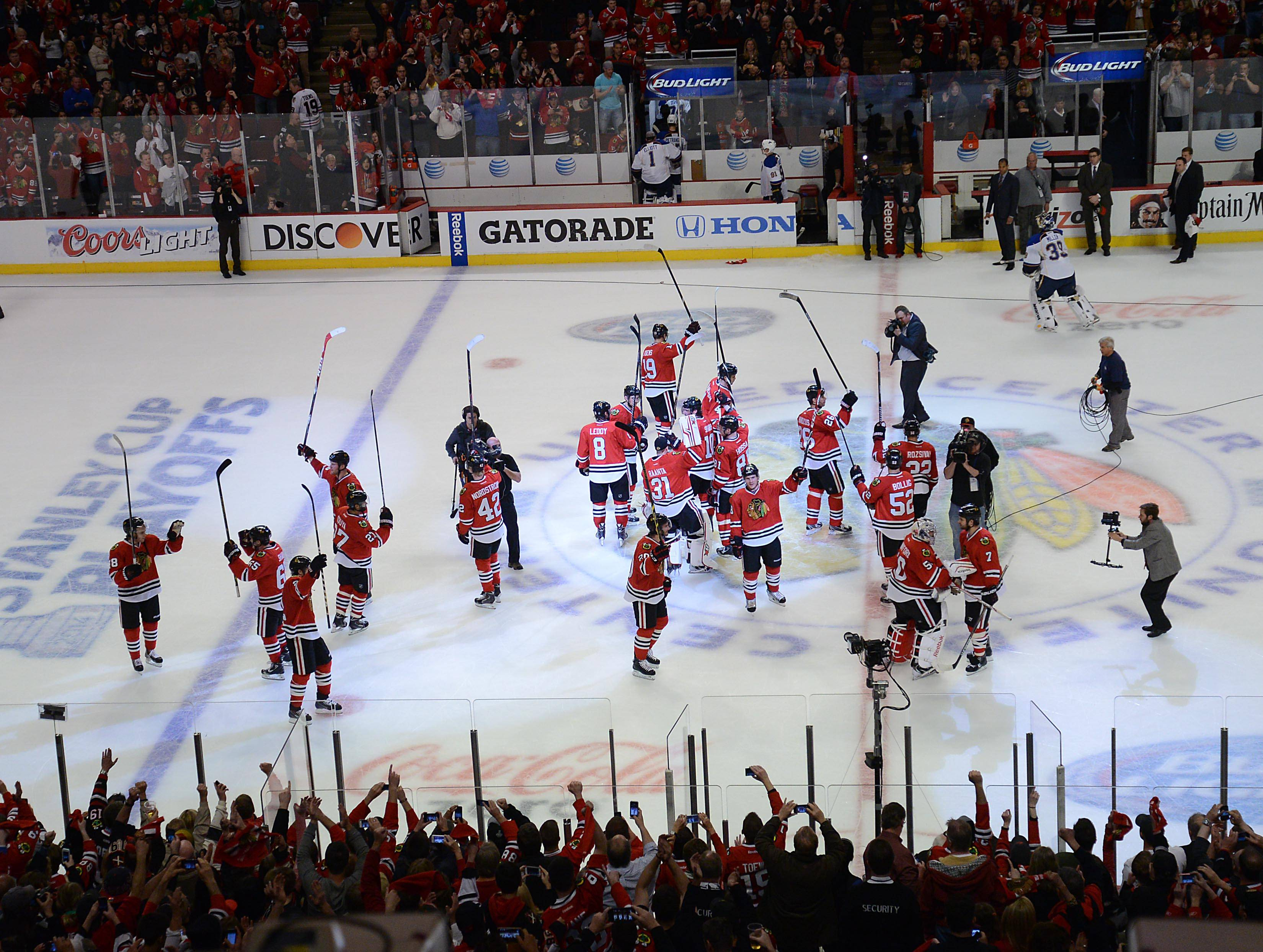 The Blackhawks raise their sticks to thank the crowd Sunday after beating the St. Louis Blues in Game 6 of the NHL first round playoffs at the United Center in Chicago. Chicago will advance to the second round.