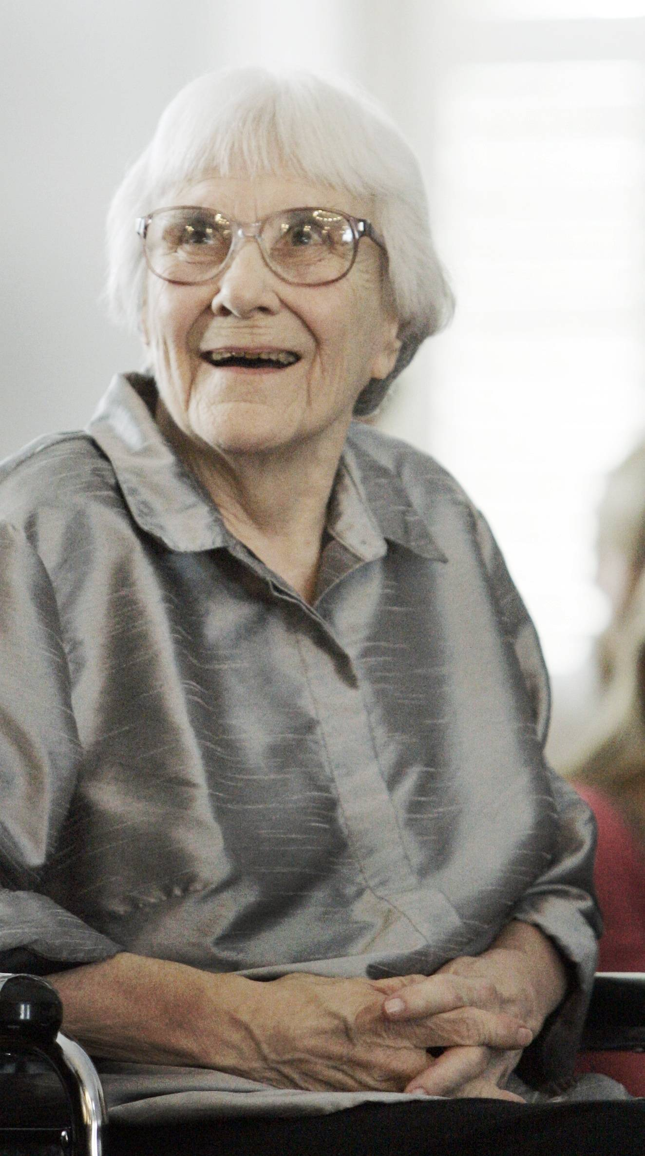 "In this Aug. 20, 2007, file photo, author Harper Lee smiles during a ceremony honoring the four new members of the Alabama Academy of Honor at the Capitol in Montgomery, Ala. ""To Kill a Mockingbird"" will be made available as an e-book and digital audiobook in July 2014."