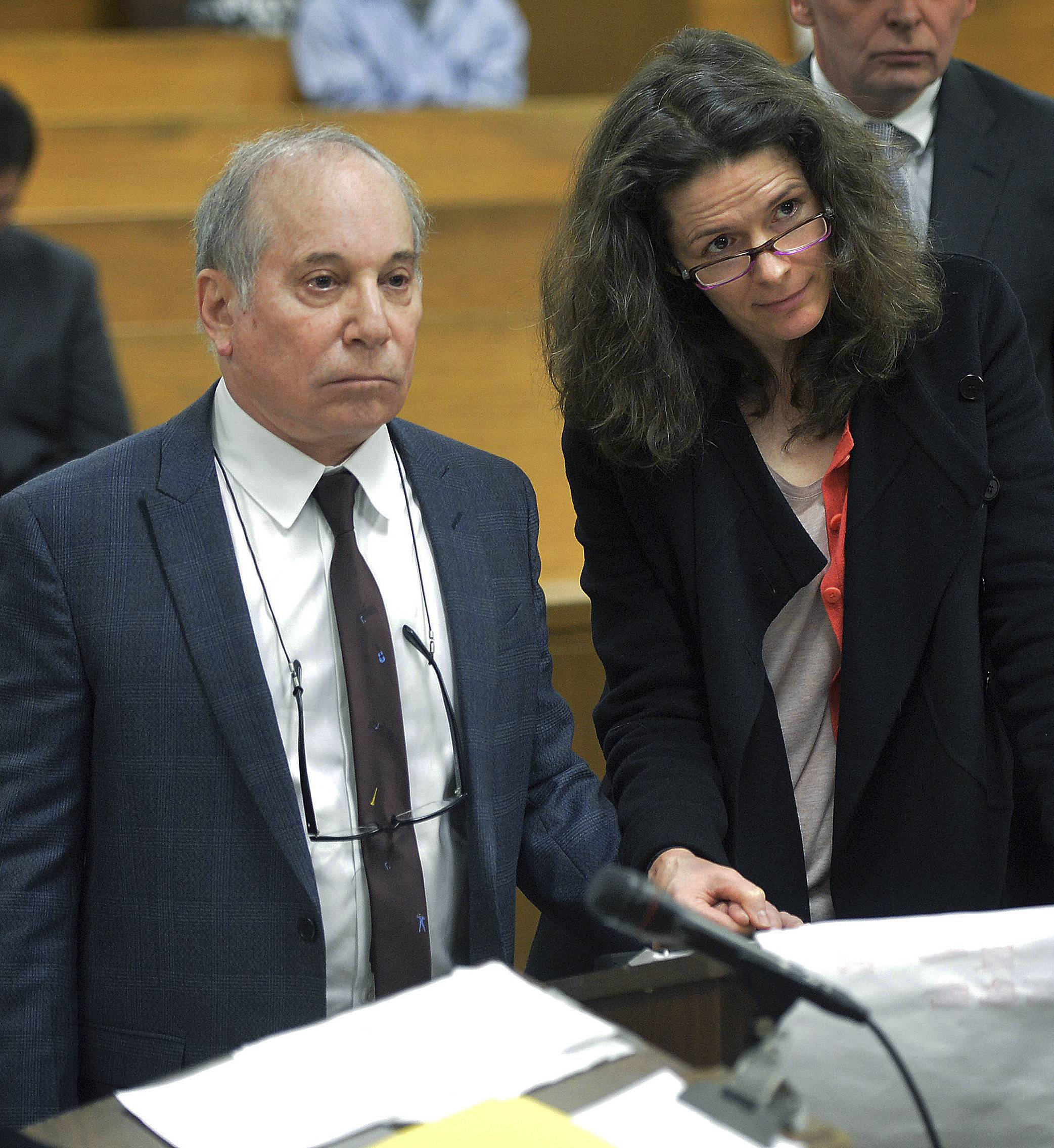 Singer Paul Simon holds hands with his wife, Edie Brickell, at a hearing in Norwalk Superior Court on Monday in Norwalk, Conn. The couple were arrested Saturday on disorderly conduct charges by officers investigating a family dispute at their home in New Canaan, Conn.