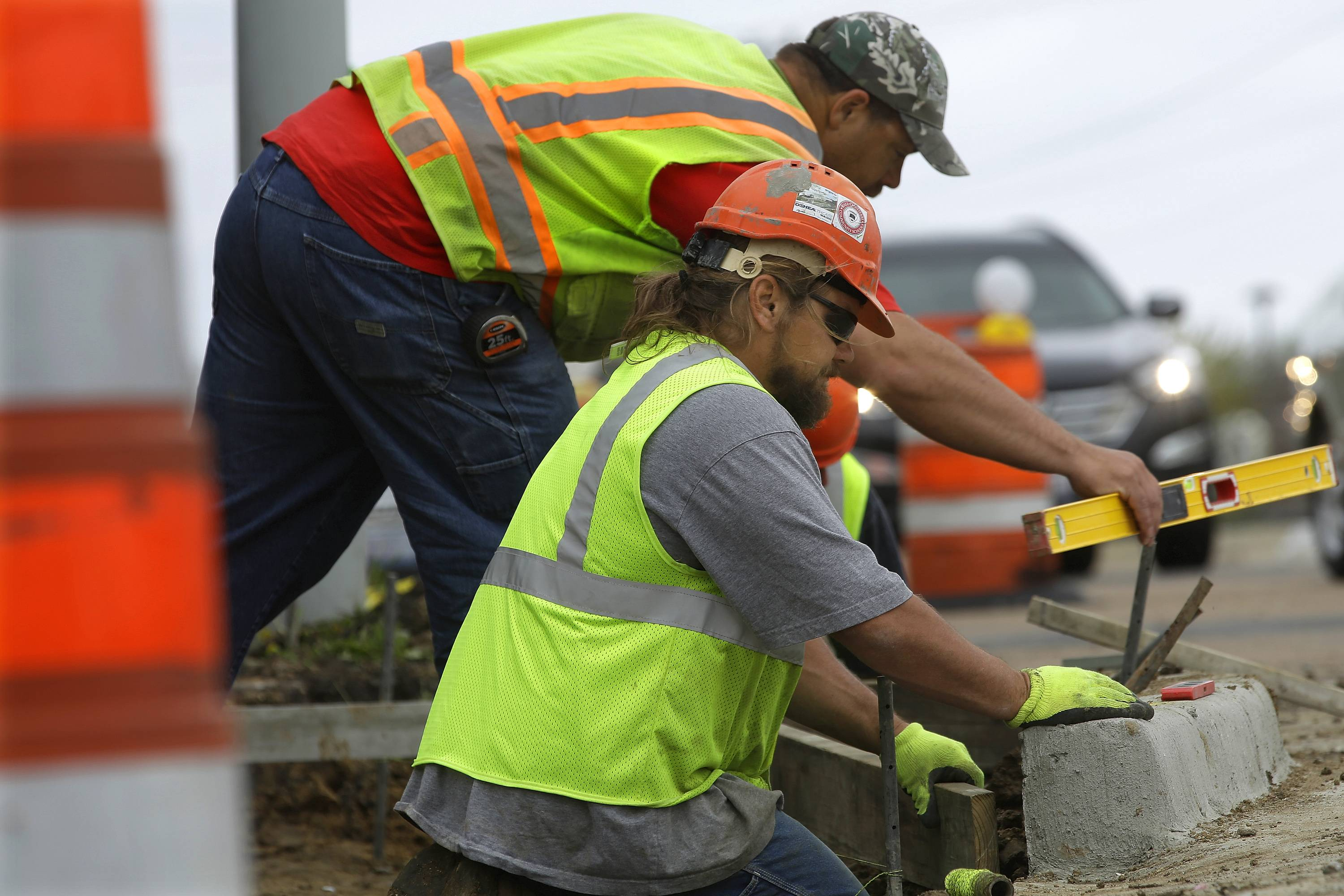 A construction crew works on a roadway Monday in Springfield. The Transportation for Illinois Coalition is sending a letter to state lawmakers this week warning that acceptable road and bridge conditions are in jeopardy over the next five years without significant new money.